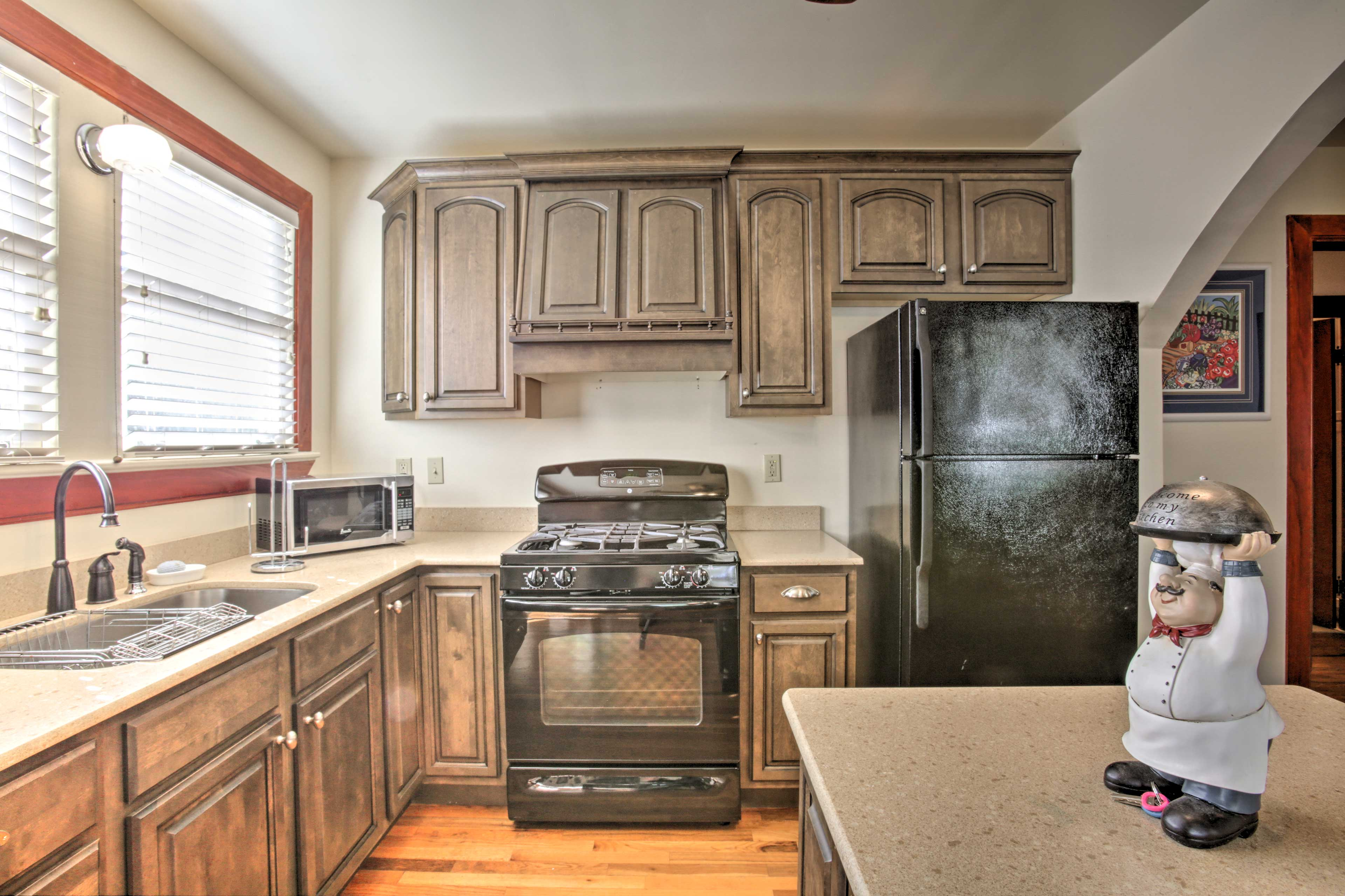 The kitchen features all the modern appliances and cookware you'll need.
