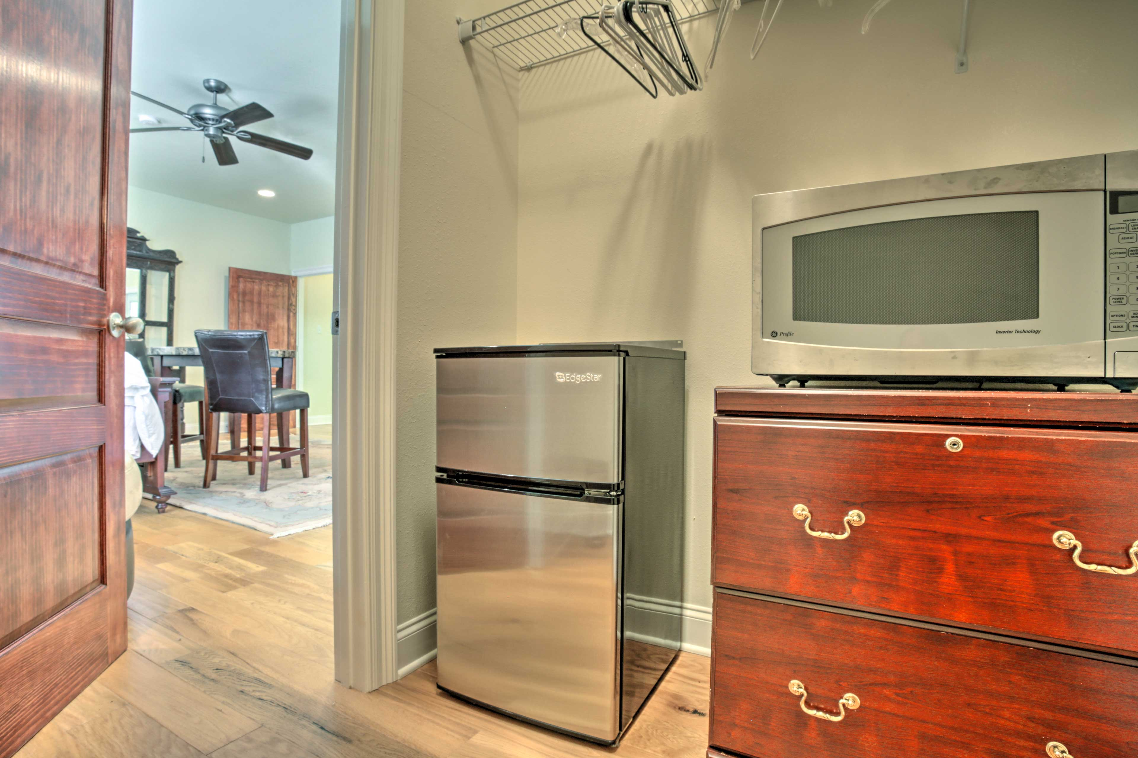 Enjoy the convenience of a mini fridge and microwave right in your bedroom!