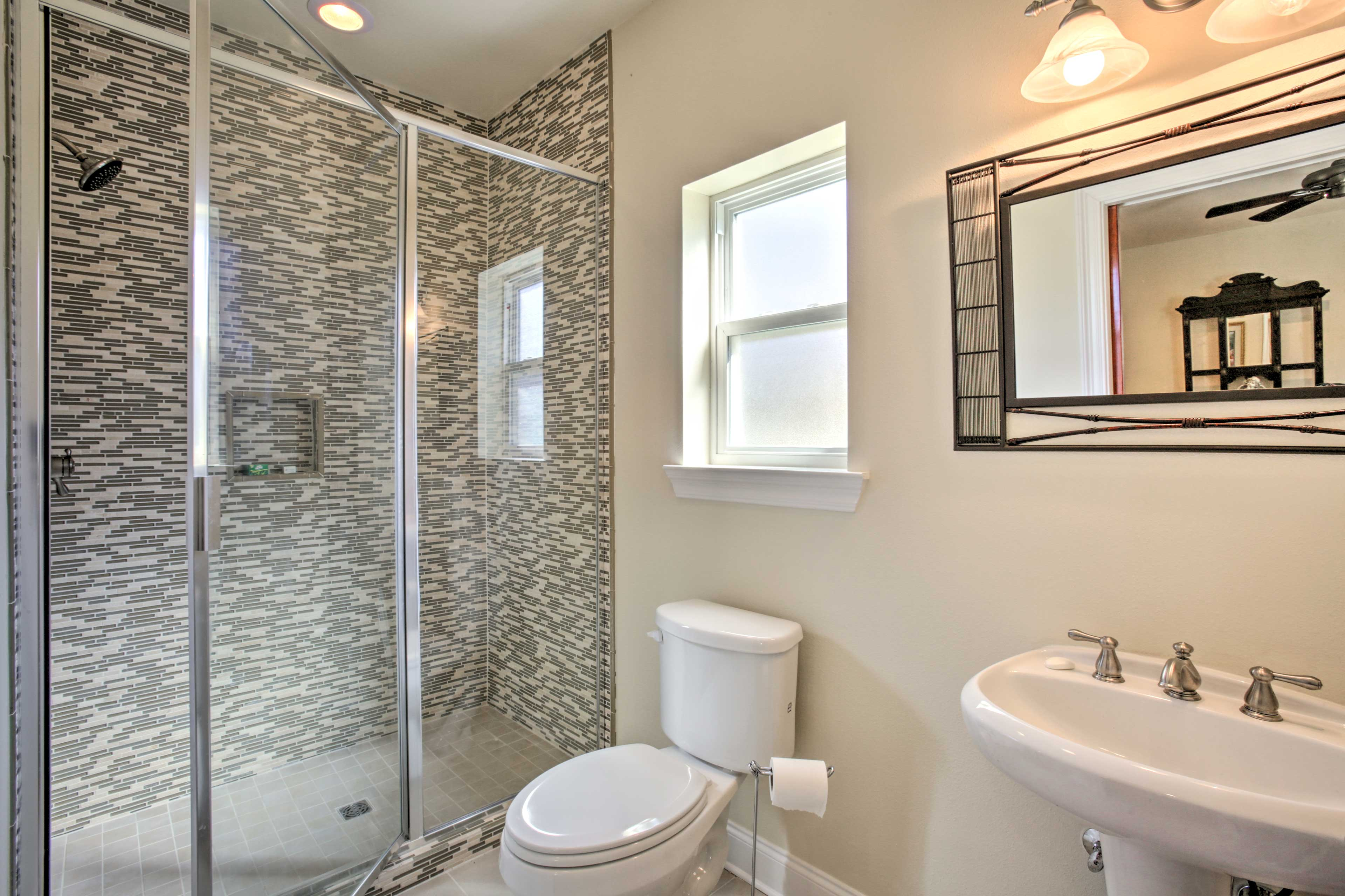 Rinse off in the walk-in glass-door shower.