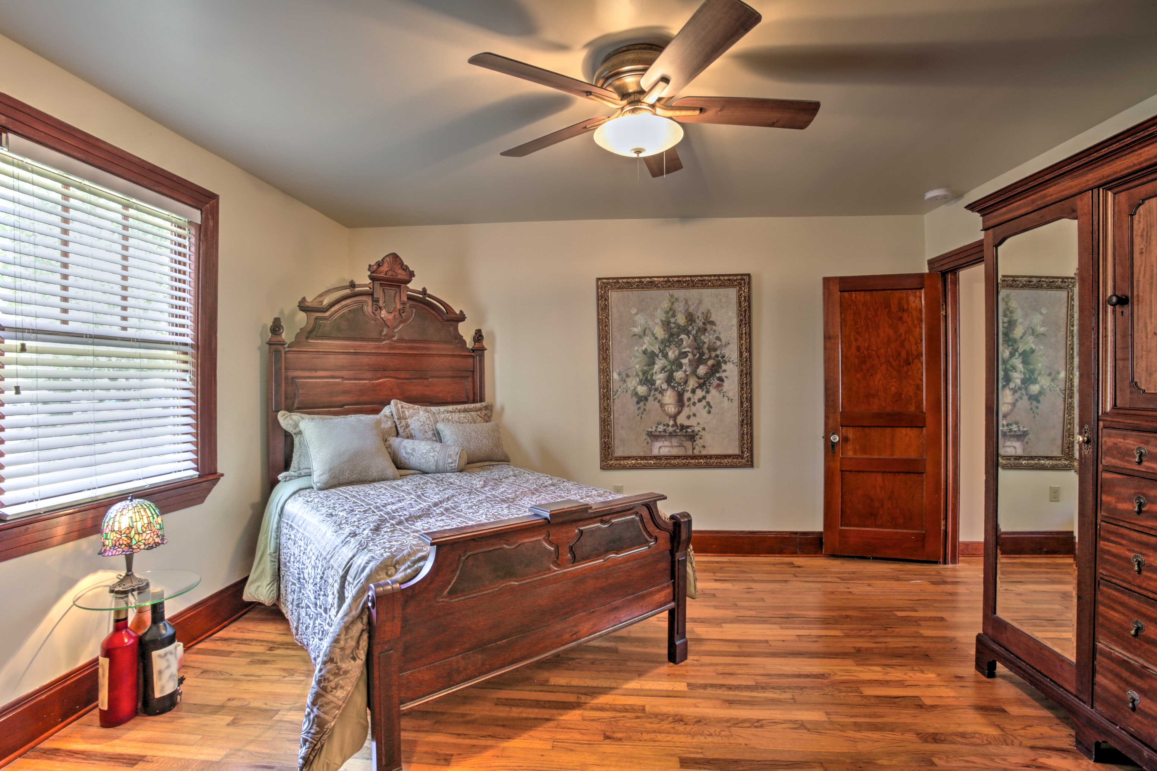 Enjoy the elegance of the third bedroom's fine wooden bedframe and decor.