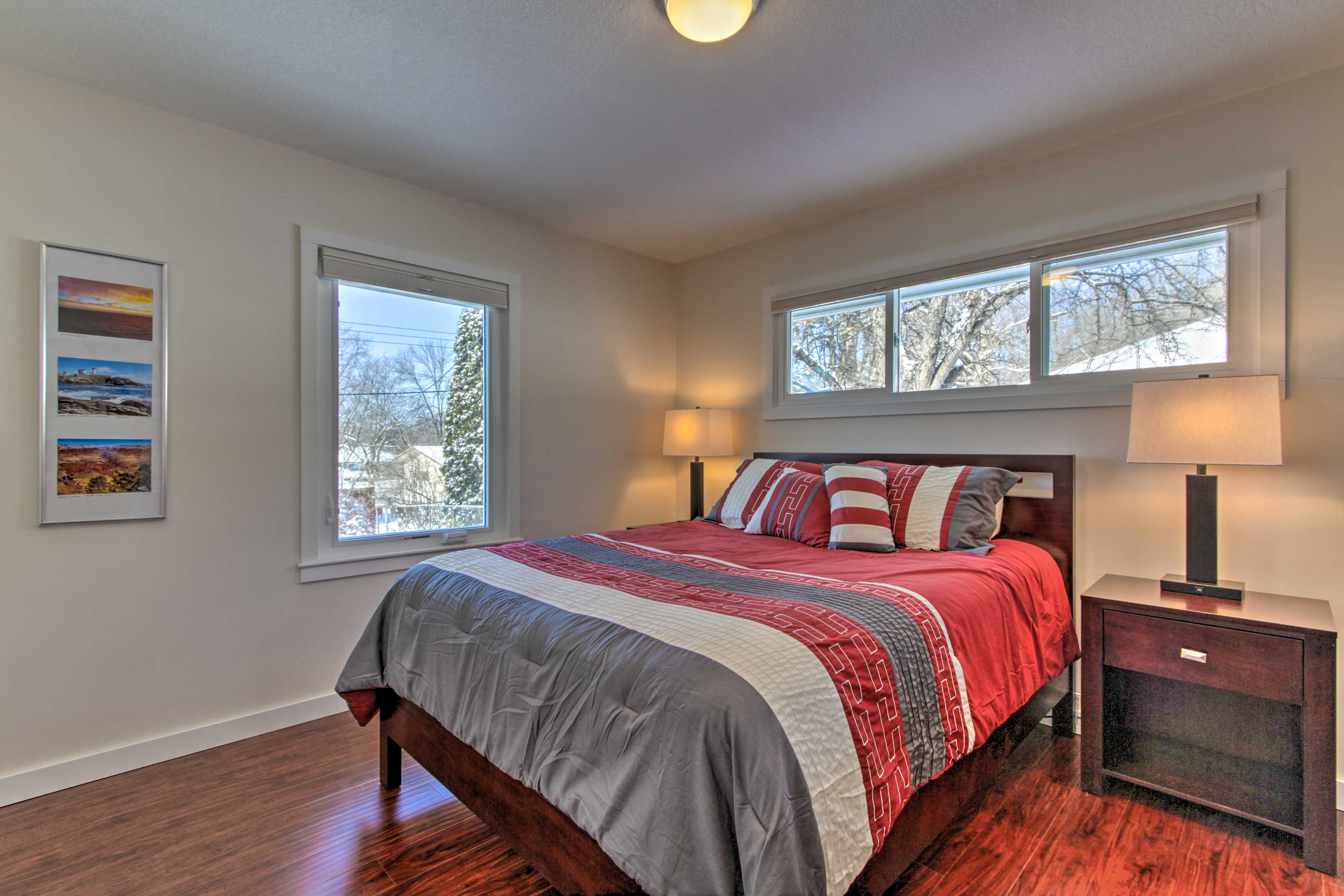 This bedroom boasts a queen-sized bed.