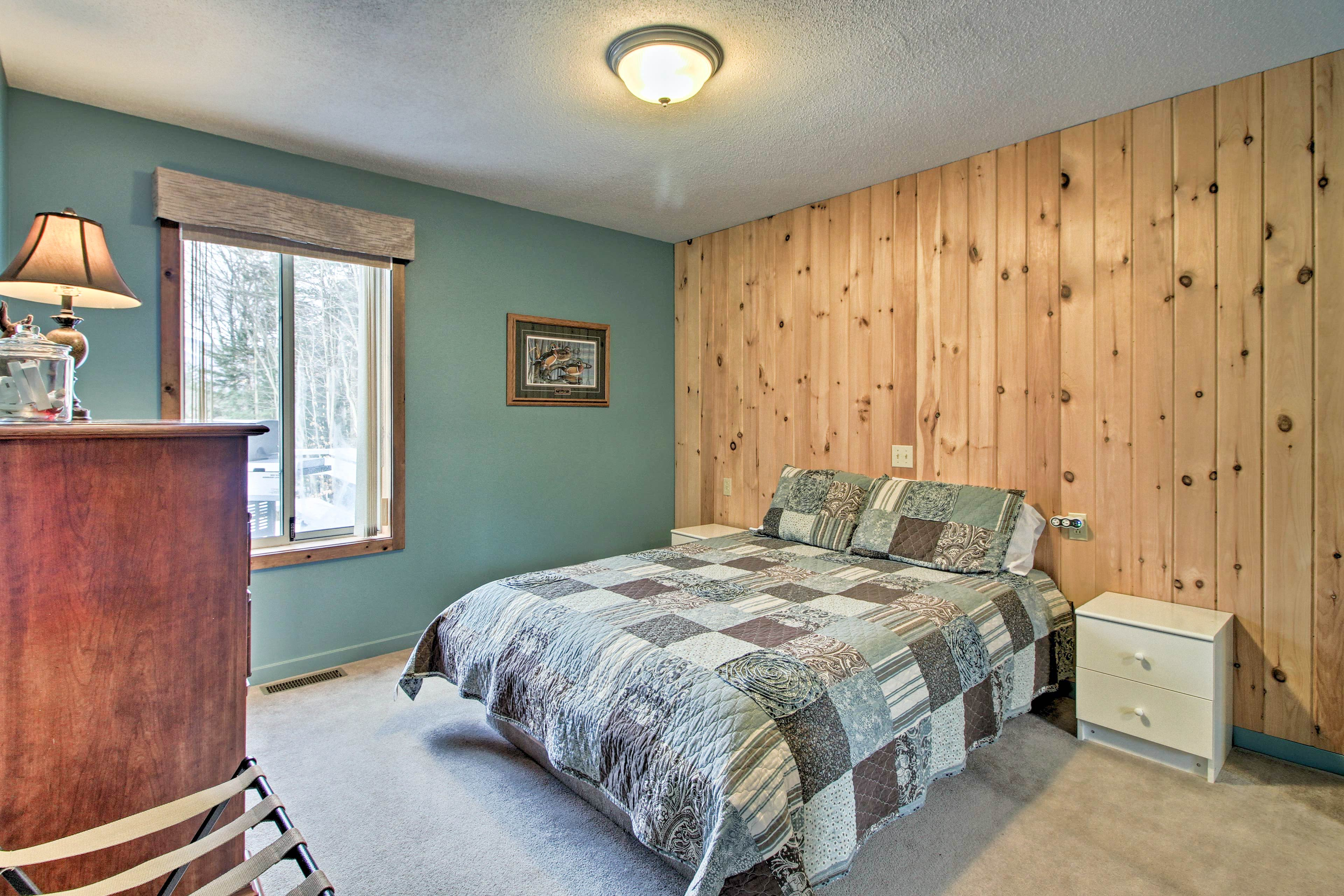 Sleep soundly in this queen bed.