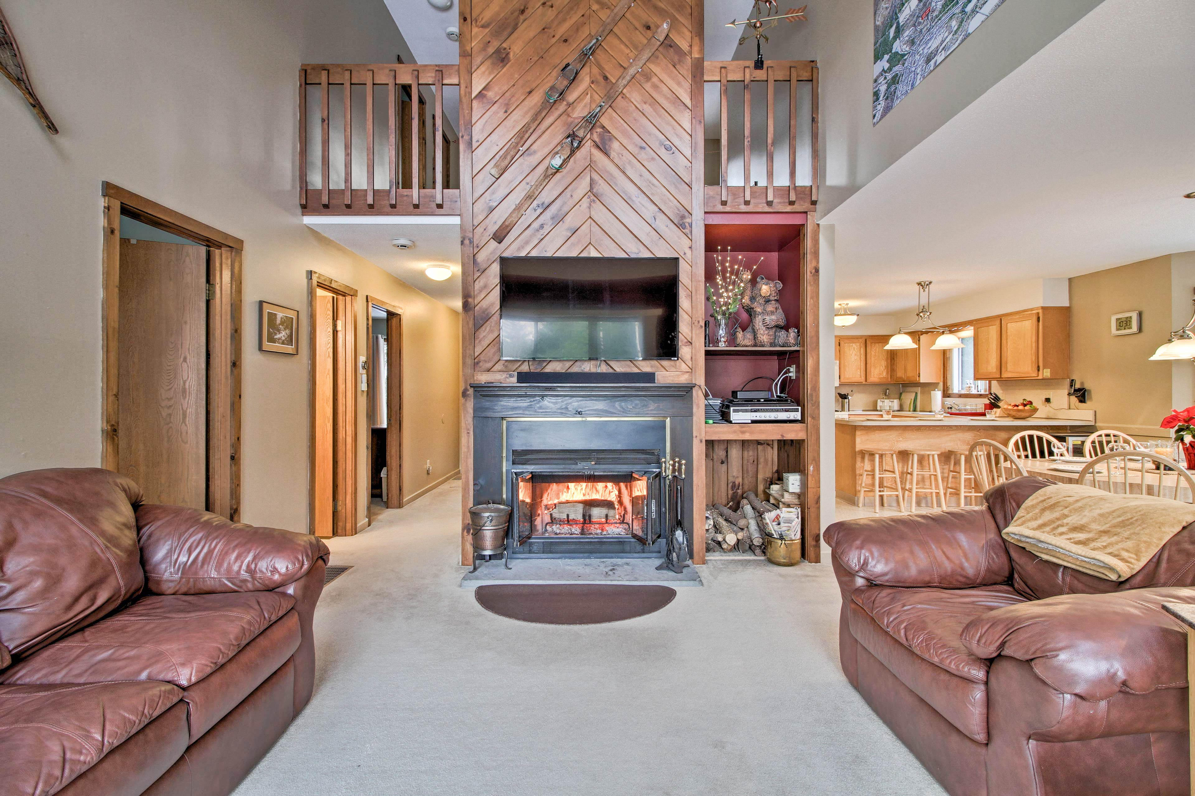 Light the fireplace and watch a show on the flat-screen cable TV.