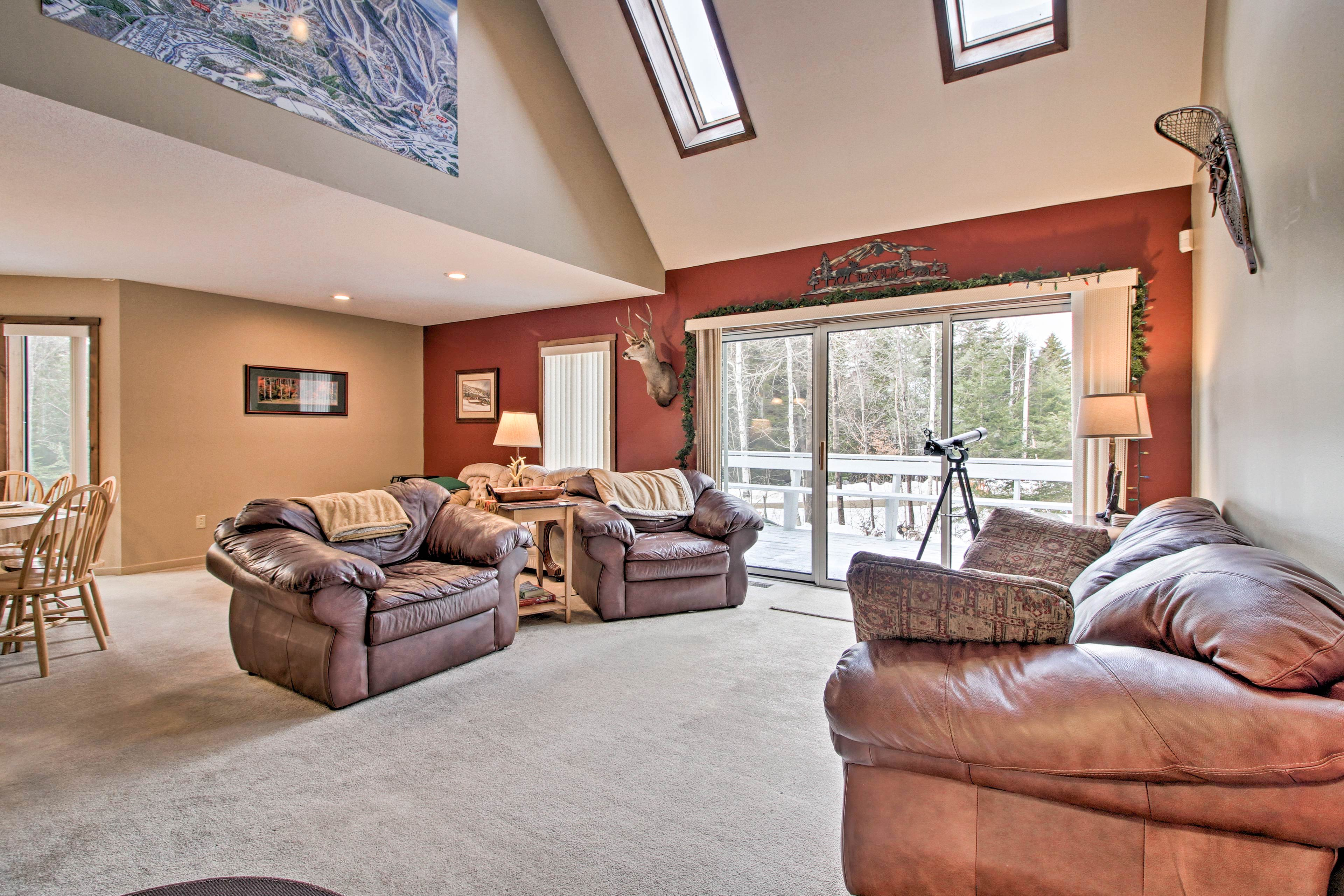 The spacious living room is complete with plush leather furniture.