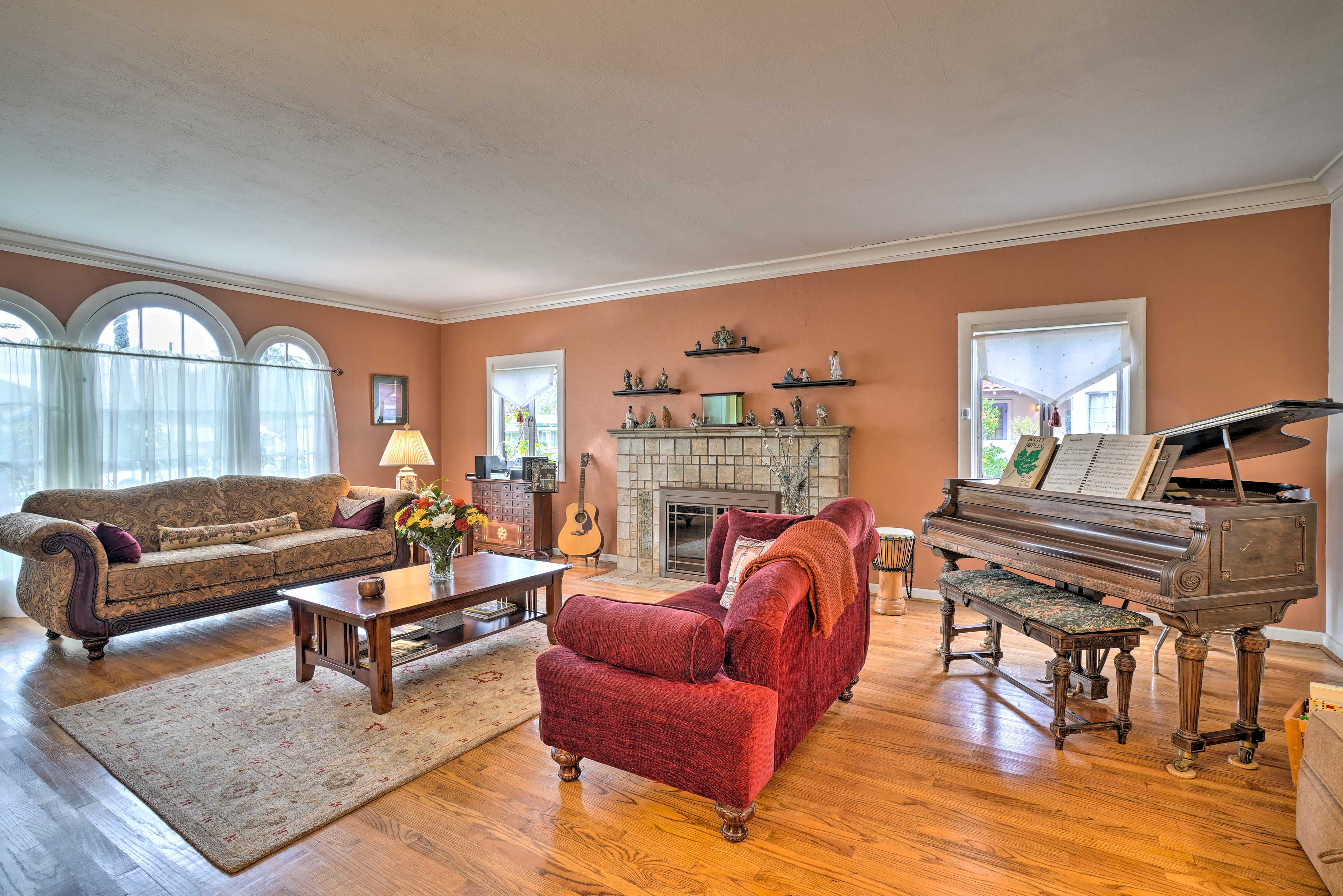 The 2,460-square-foot interior features a large gas fireplace and piano!