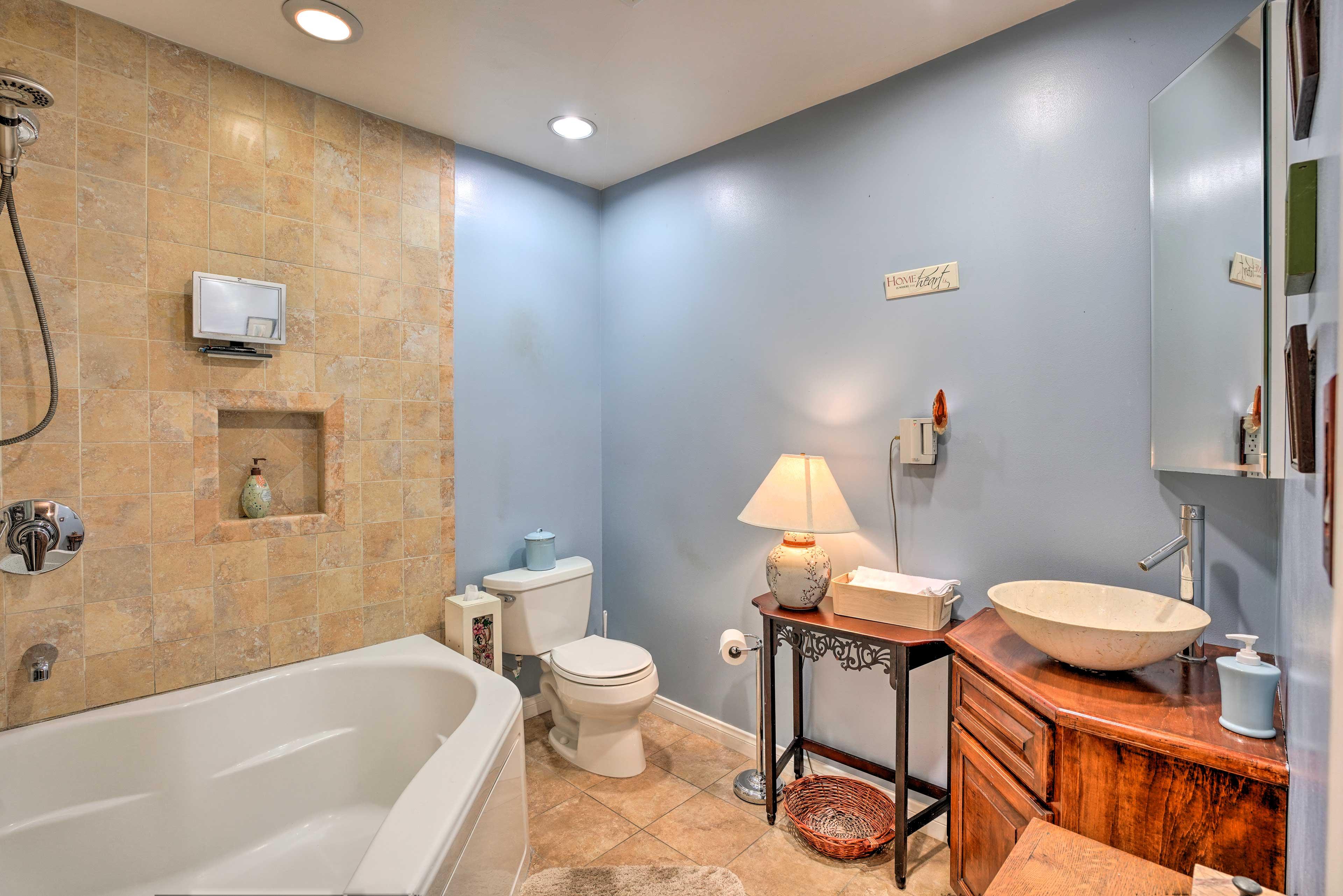 Enjoy a relaxing soak in this en-suite bathroom.