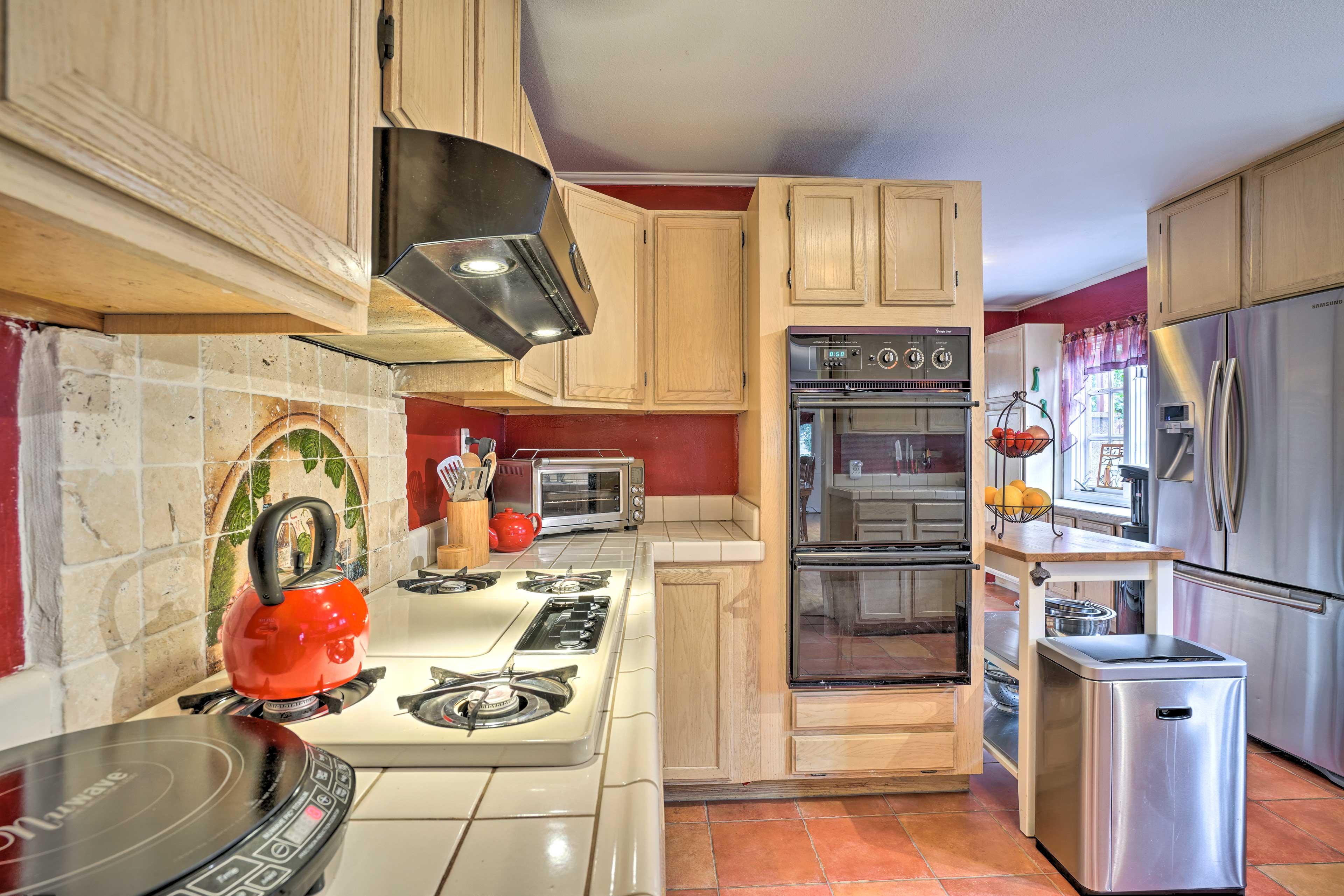 The tile backsplash adds a unique charm to the kitchen.