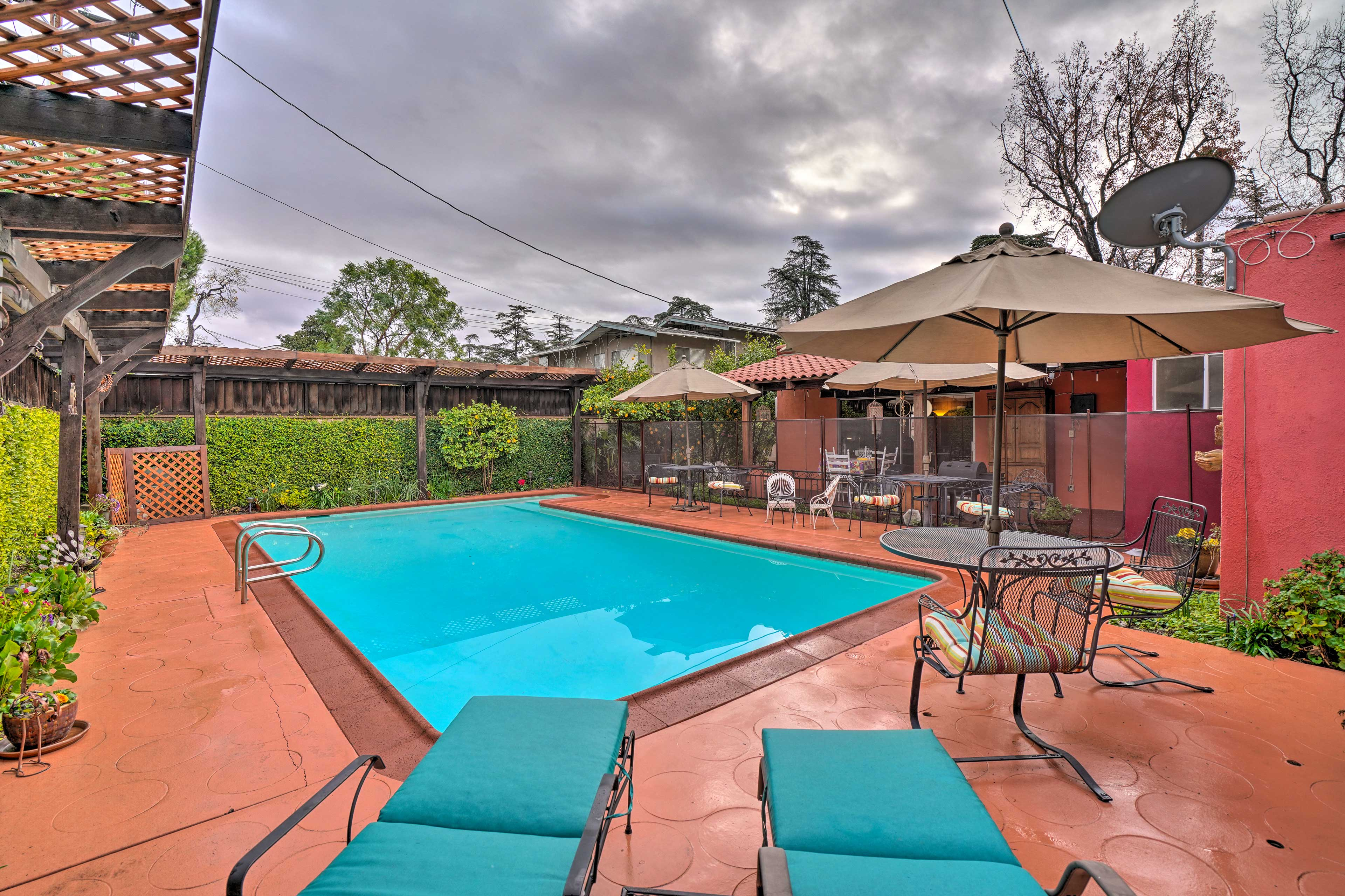 This private patio area offers a swimming pool, lounge chairs, and ample seating