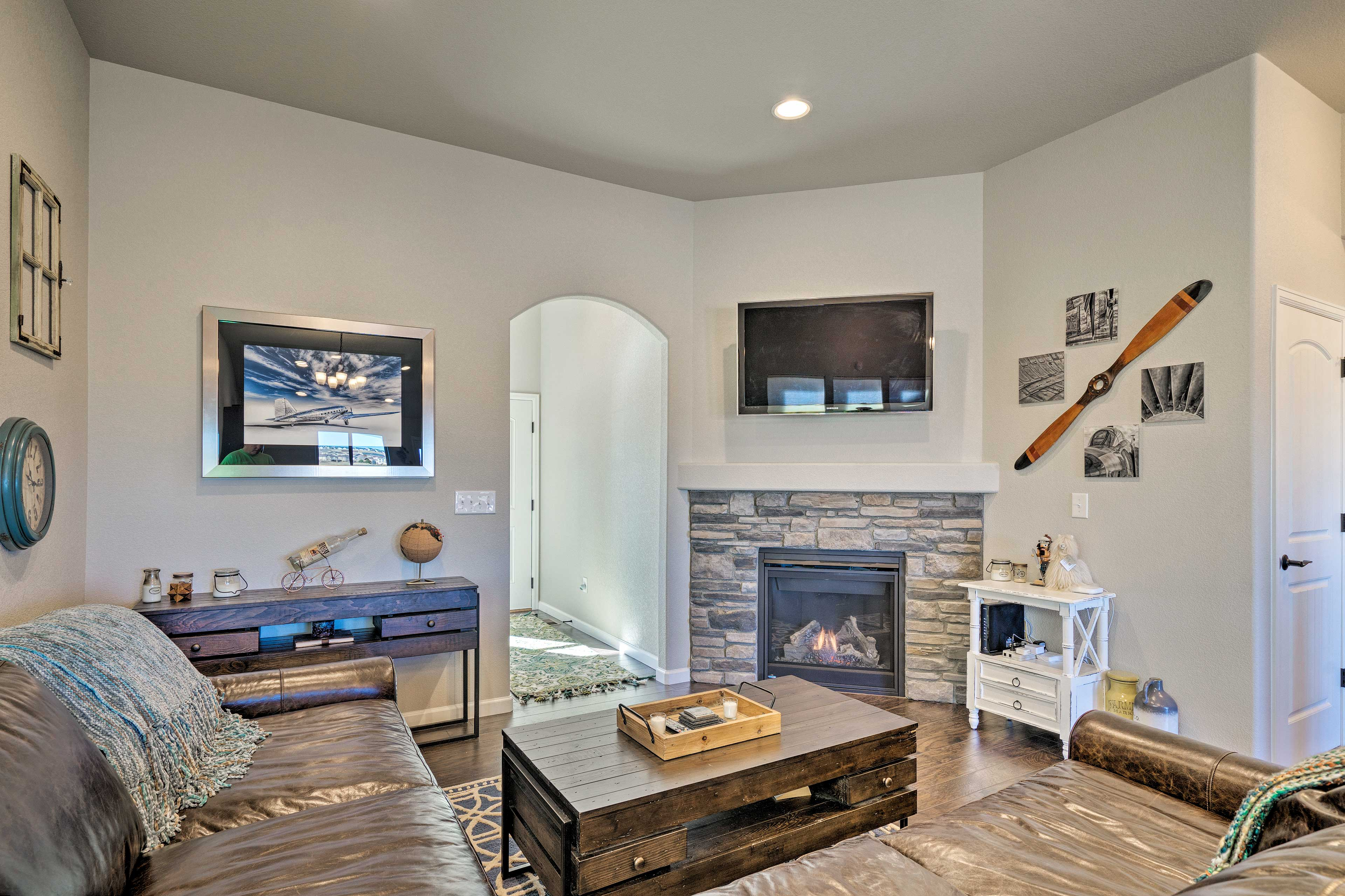 Sink into the sectional sofa while a movie plays and the fireplace flickers!