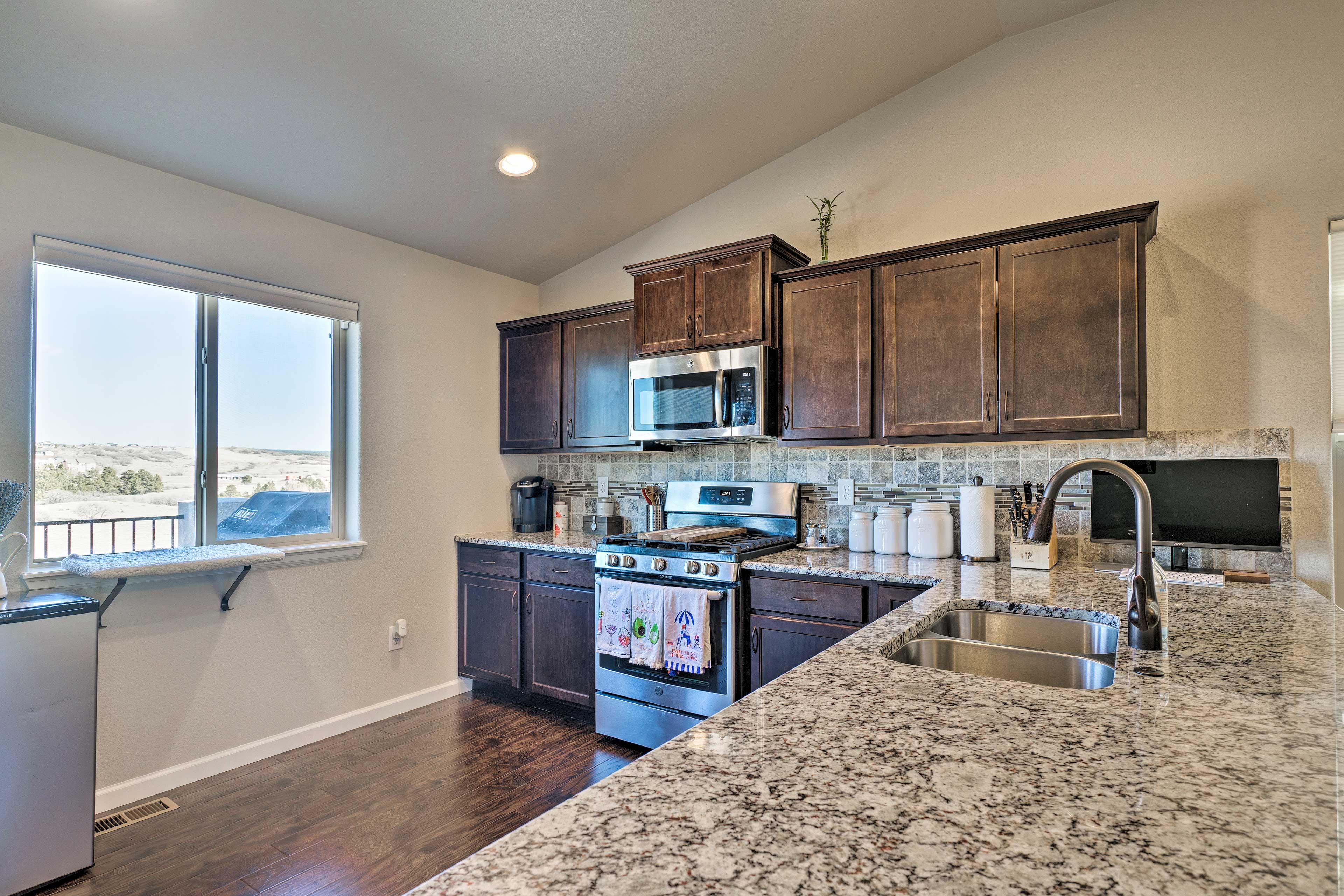 Serve snacks or sip drinks at the sleek, granite countertops.