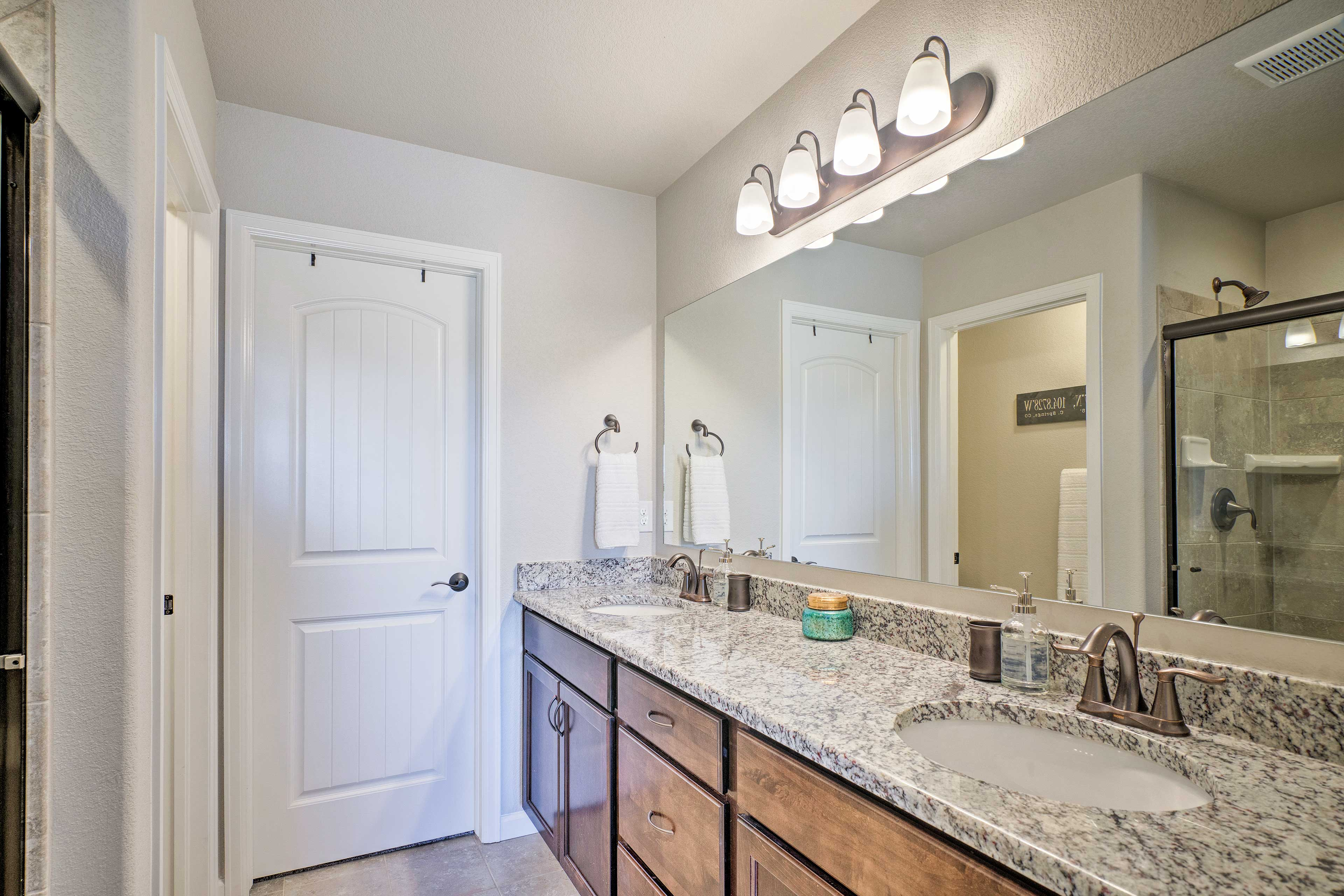The master's en-suite bath includes double sinks and a walk-in shower.