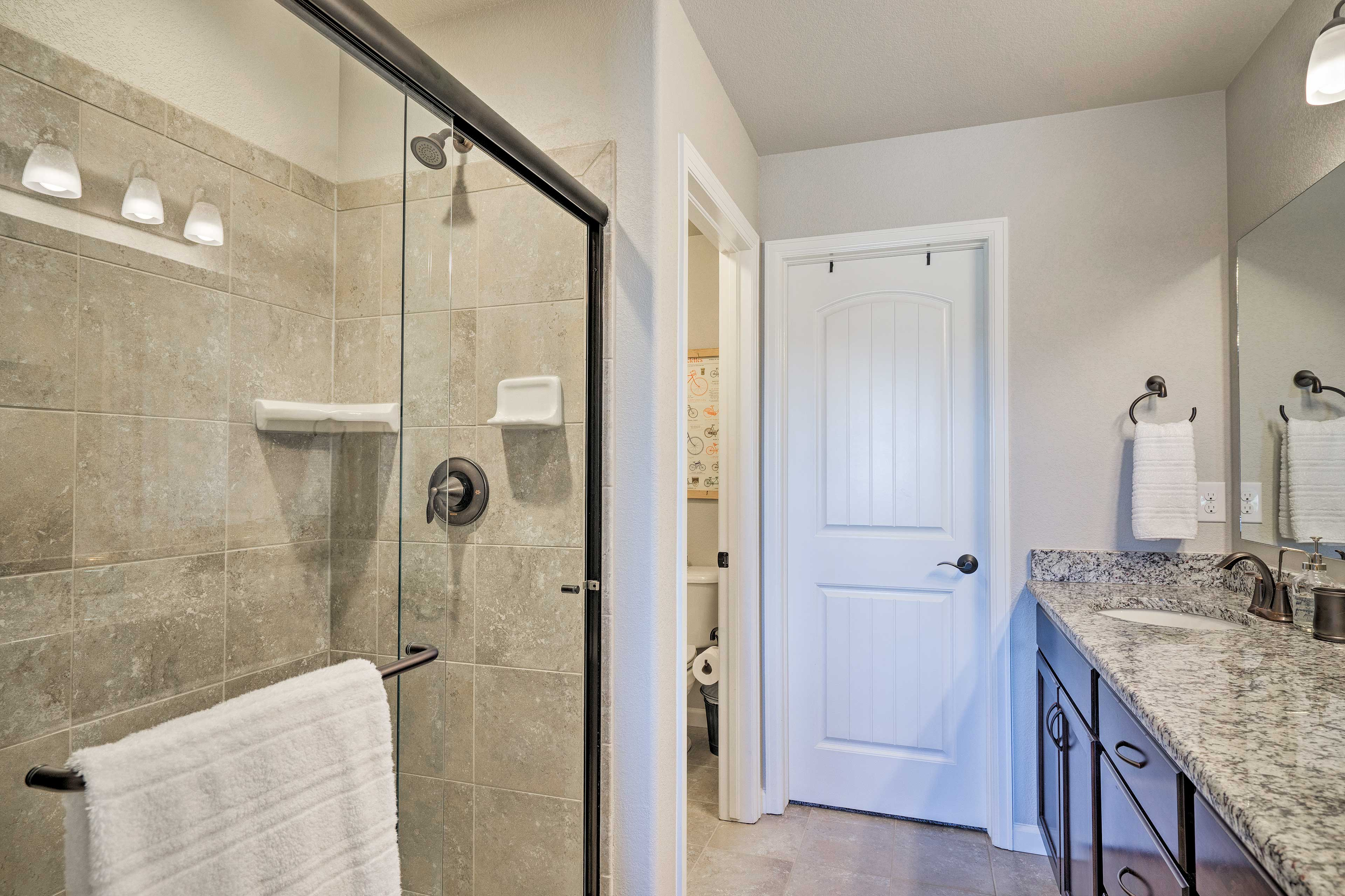 After a day of hiking, rinse off in this spacious glass-door shower!