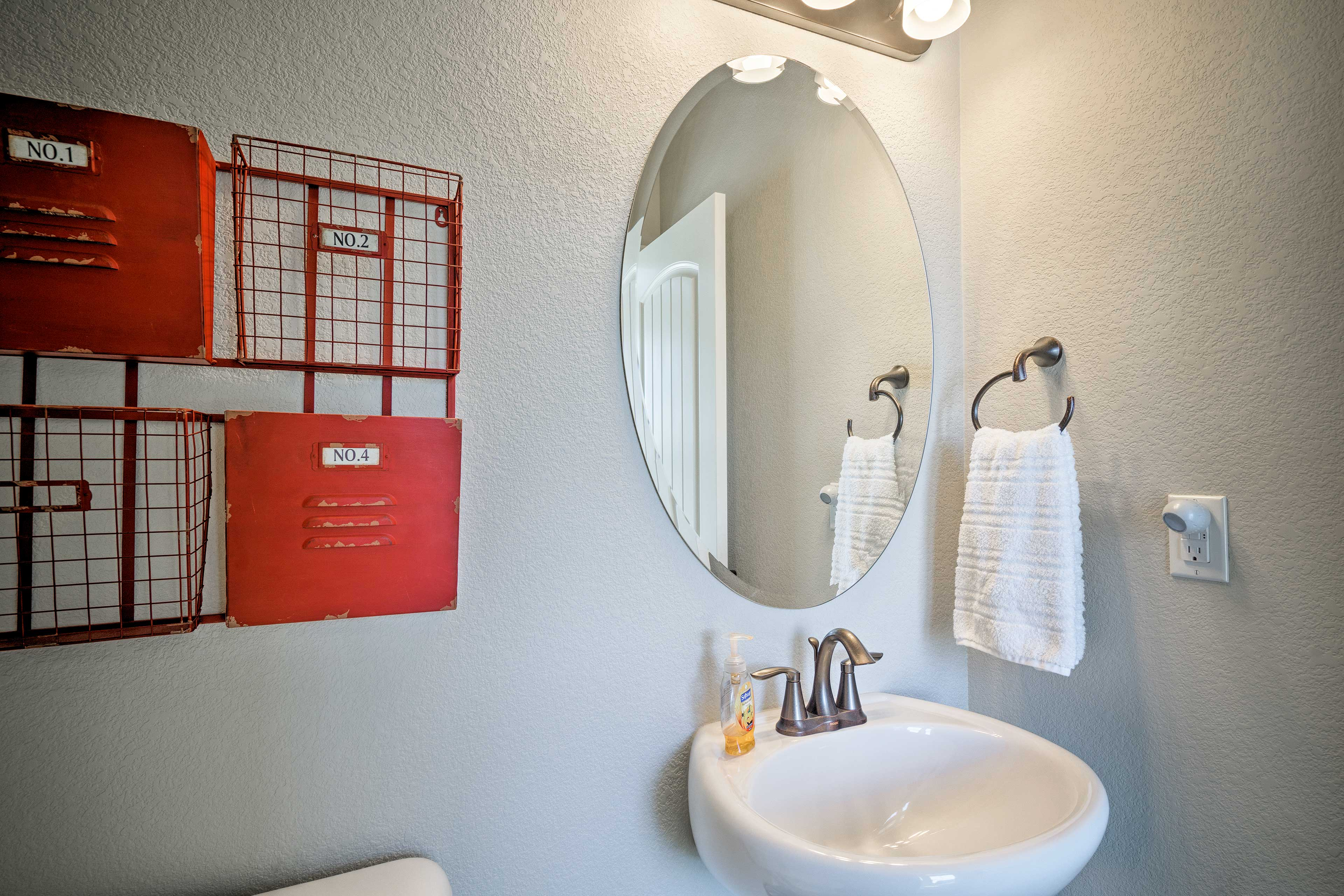 The home features 2 full bathrooms and 1 half bath.