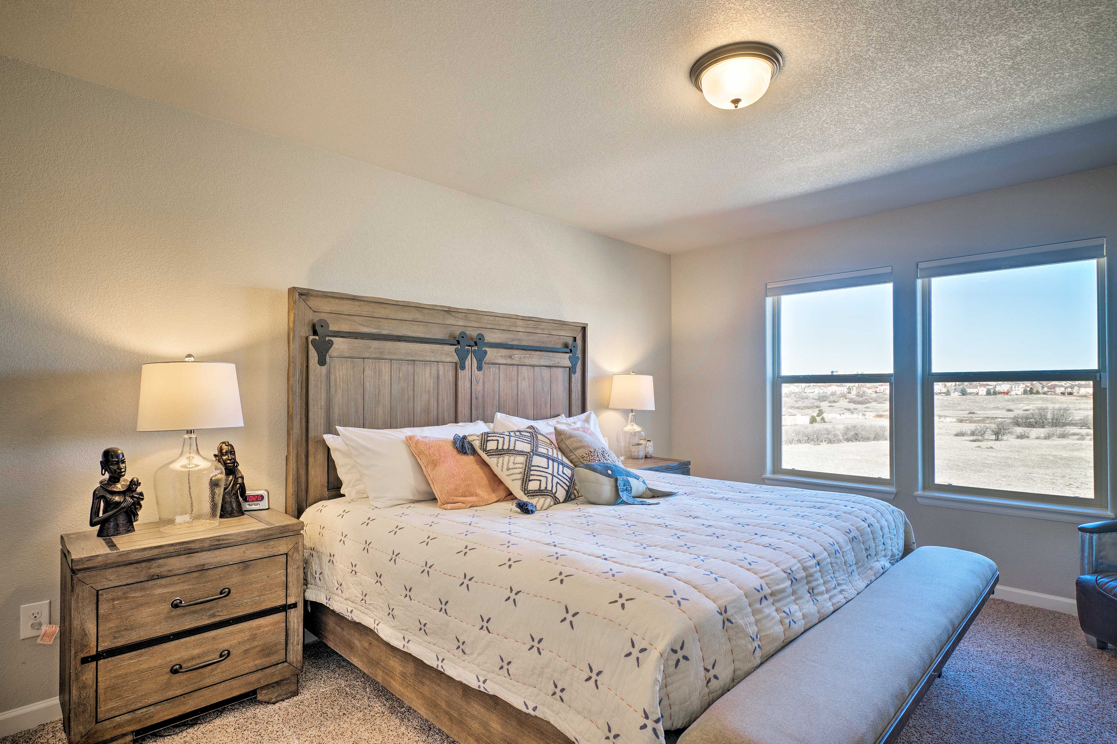 Upstairs, the master bedroom boasts a luxurious king-sized bed.