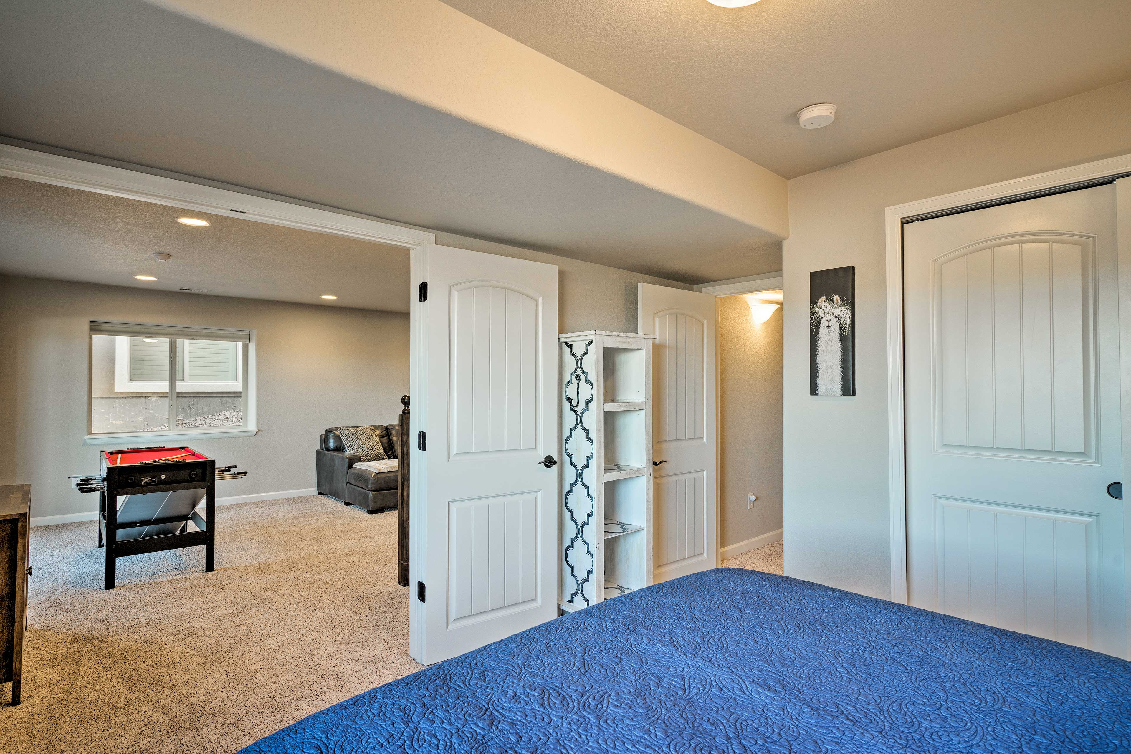 Double doors open up to reveal a comfortable downstairs bedroom!