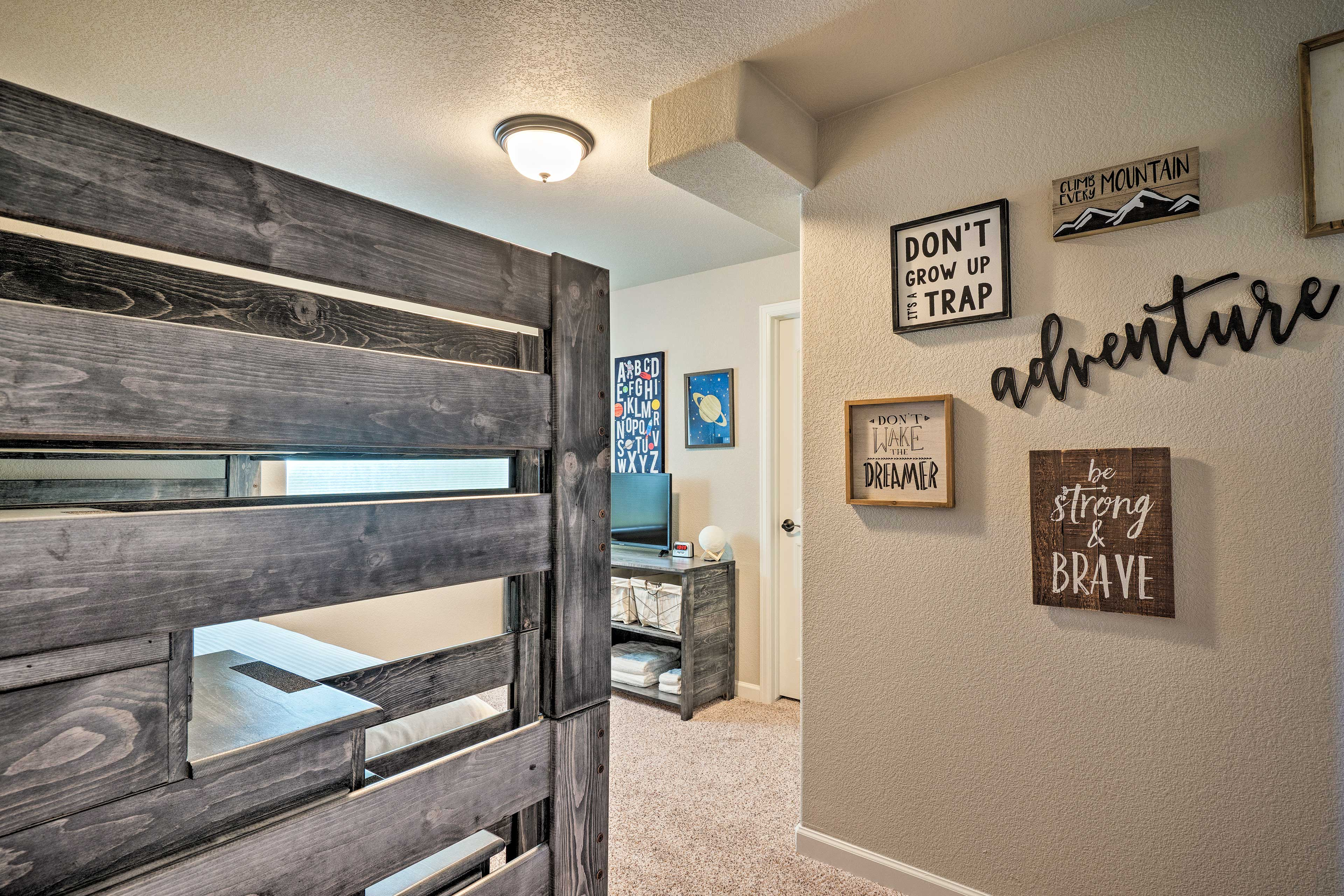 Kids will have no problem drifting off to dreamland in this cozy bunk room!
