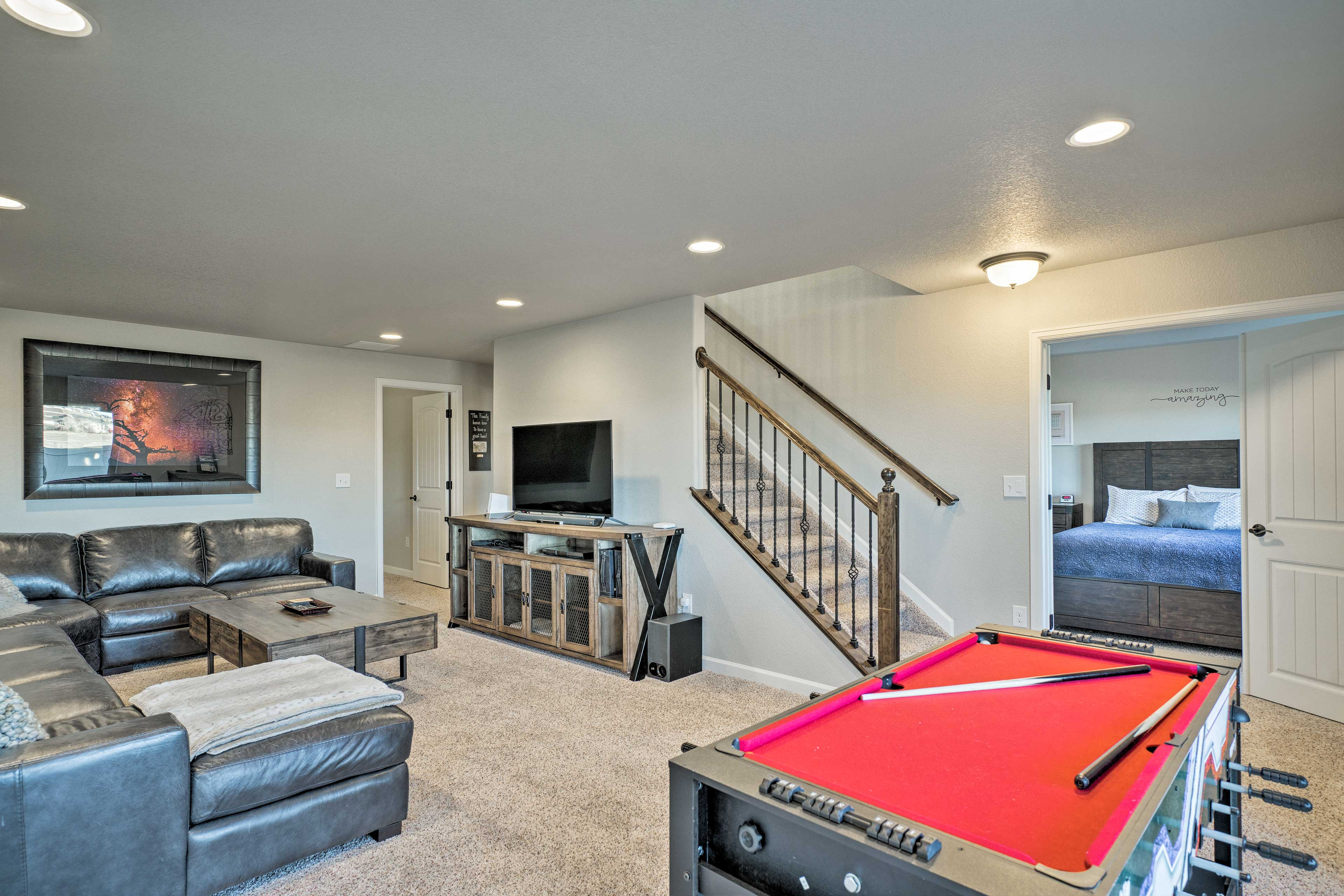 This modern townhome is complete with a game room, balcony, & mountain views!