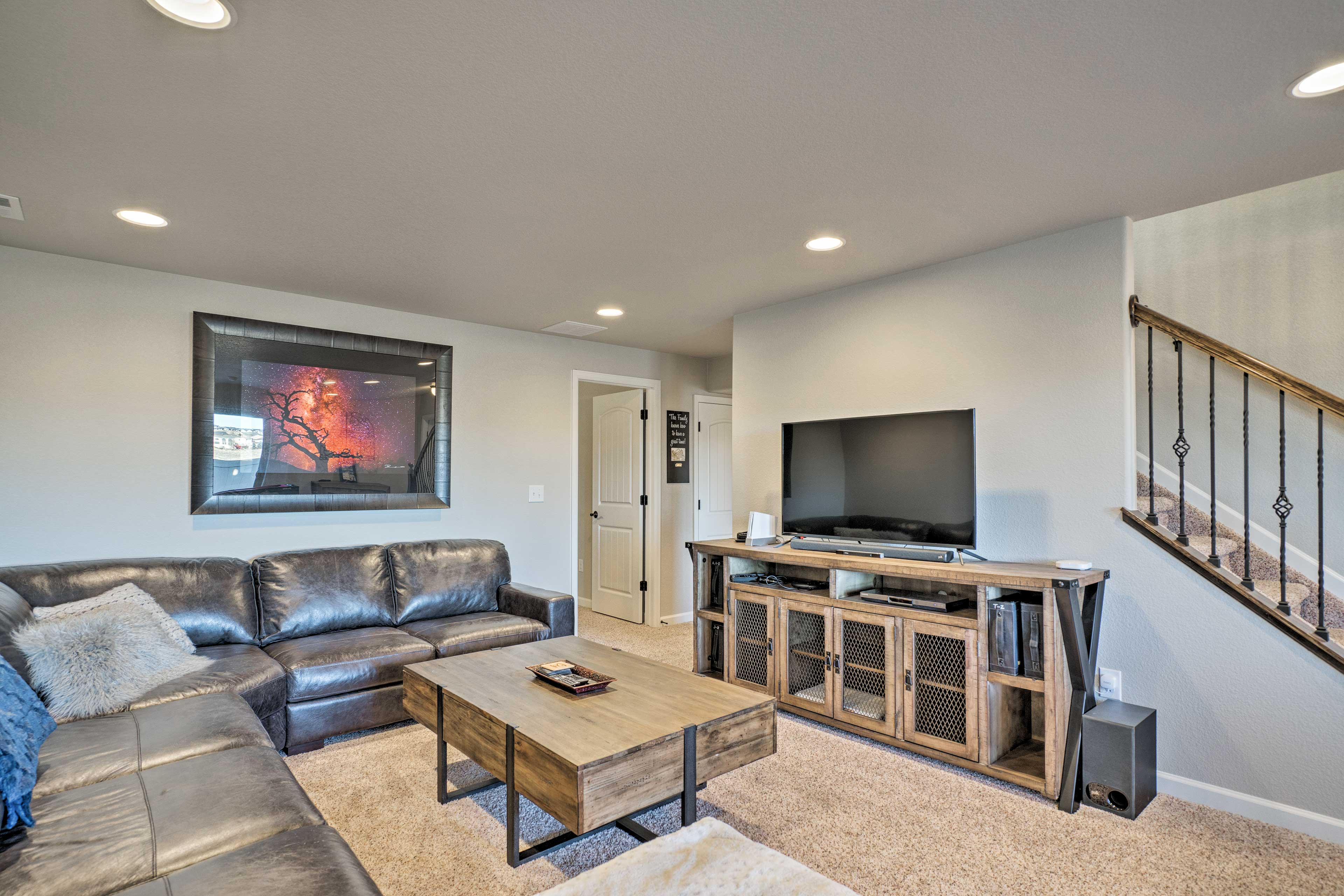 The basement has a multi-use table for pool & foosball, with a flat-screen TV.