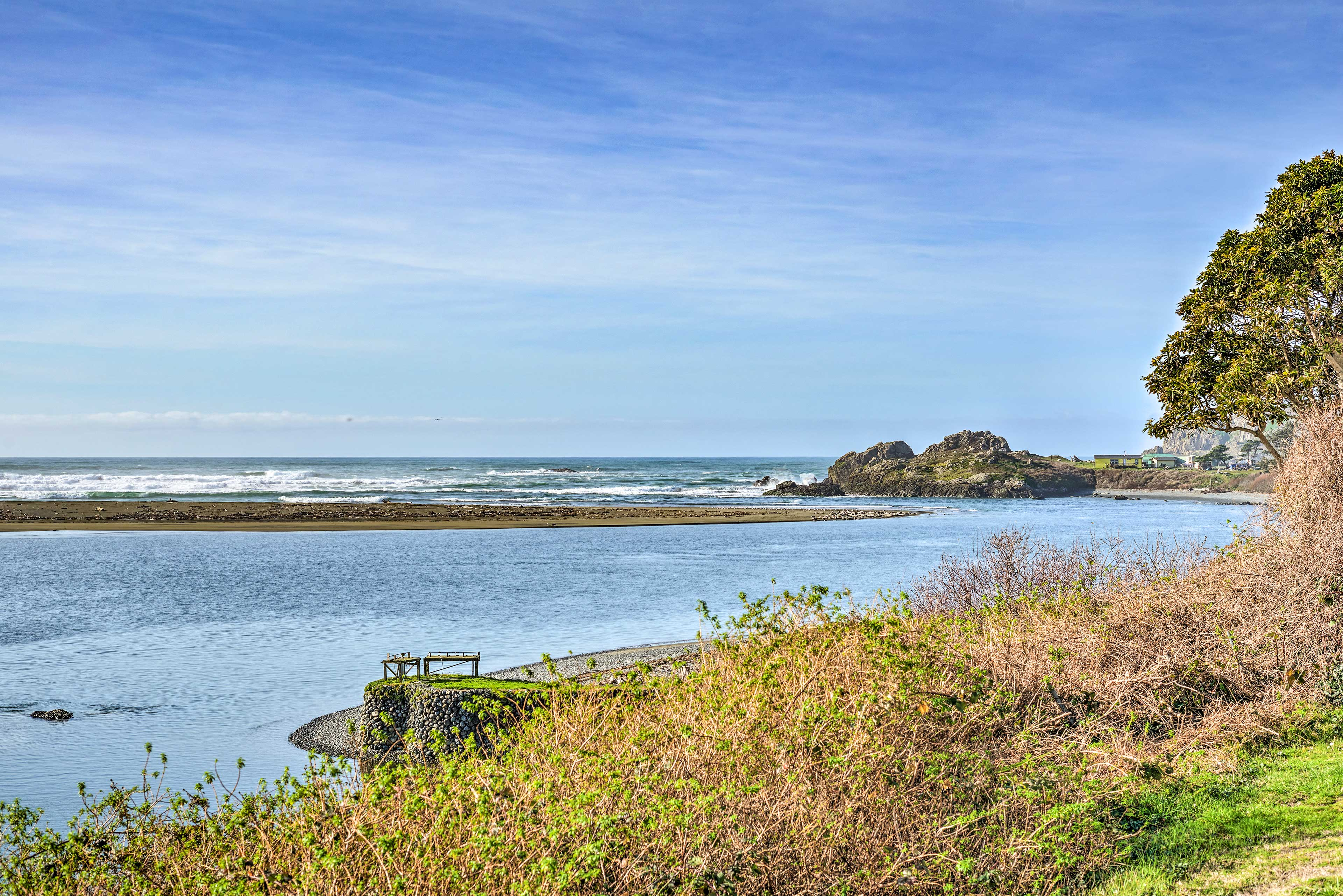 The Pacific Ocean is mere steps from the home.