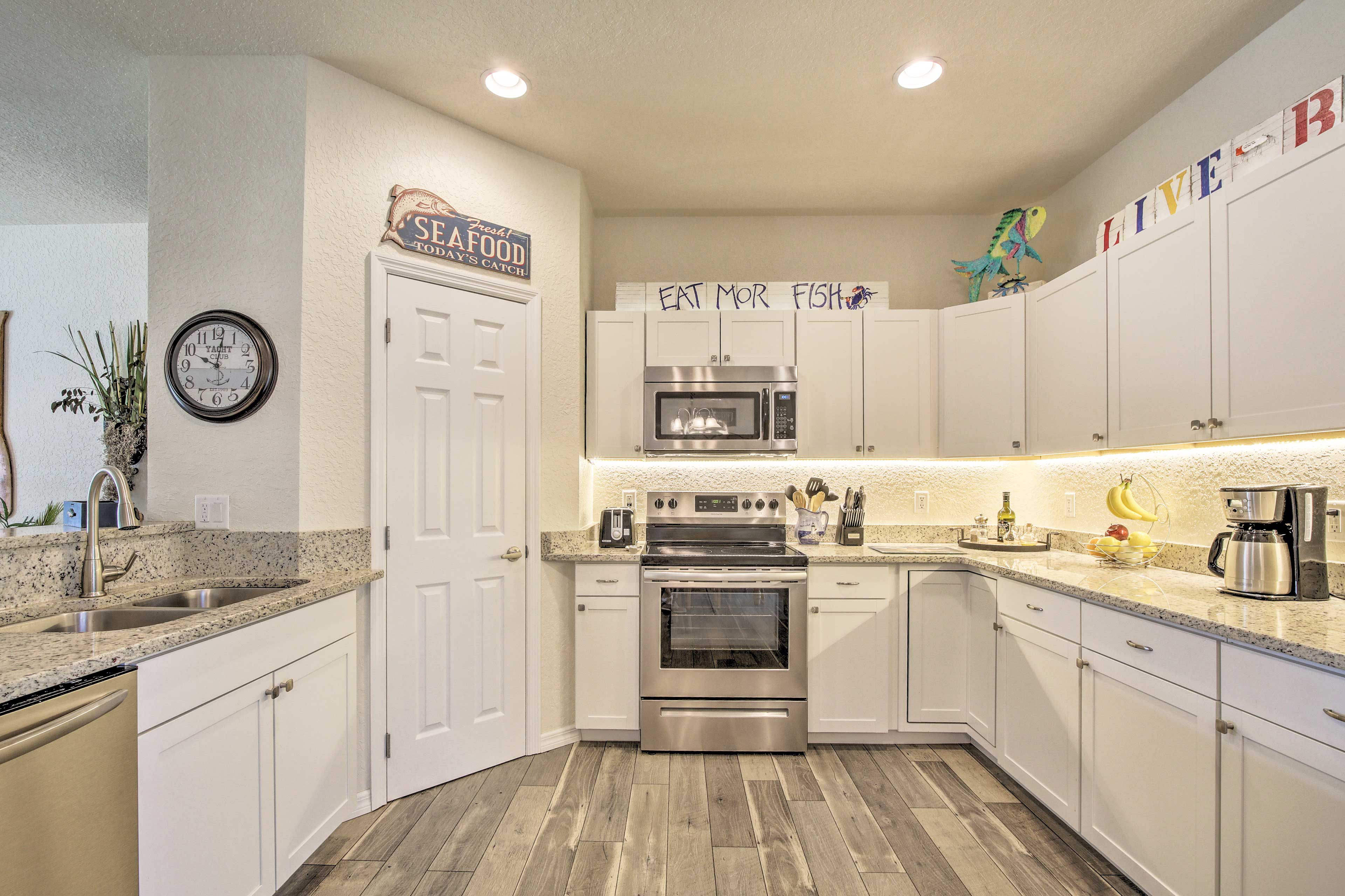 Stainless steel appliances are featured in the kitchen.