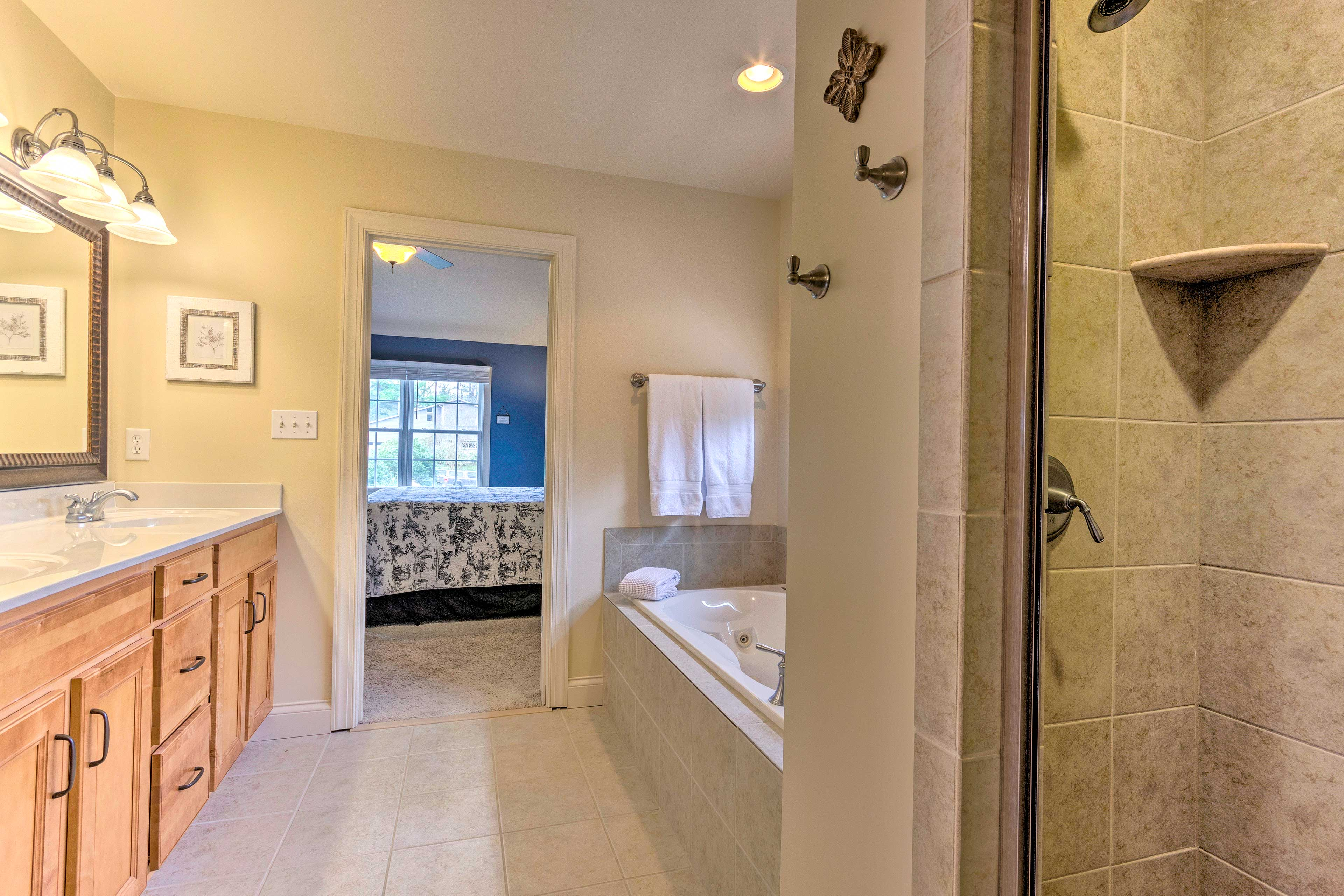 The master en-suite bathroom is equipped with a jetted tub and walk-in shower.