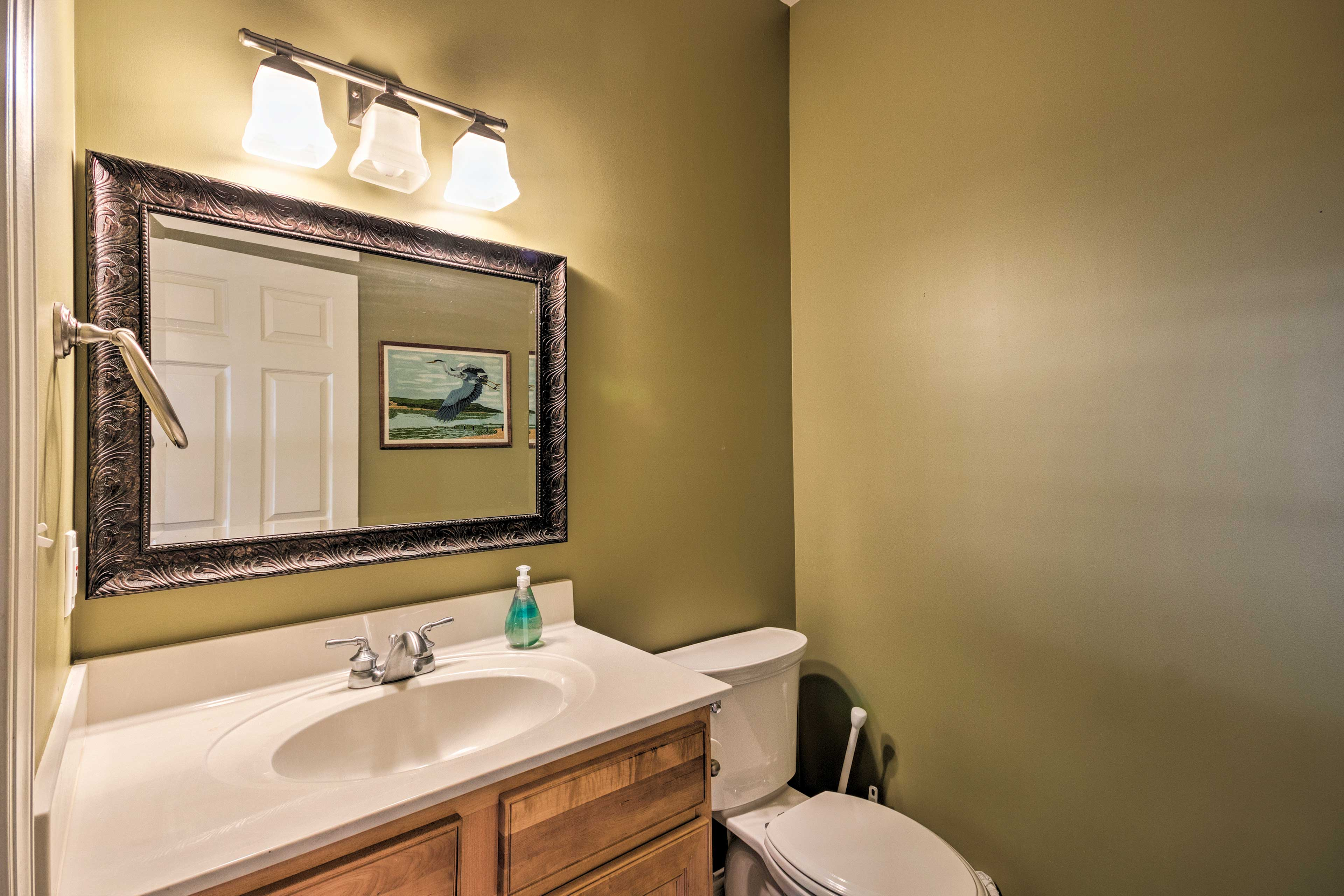There are 2 full bathrooms and a half-bath in this home.