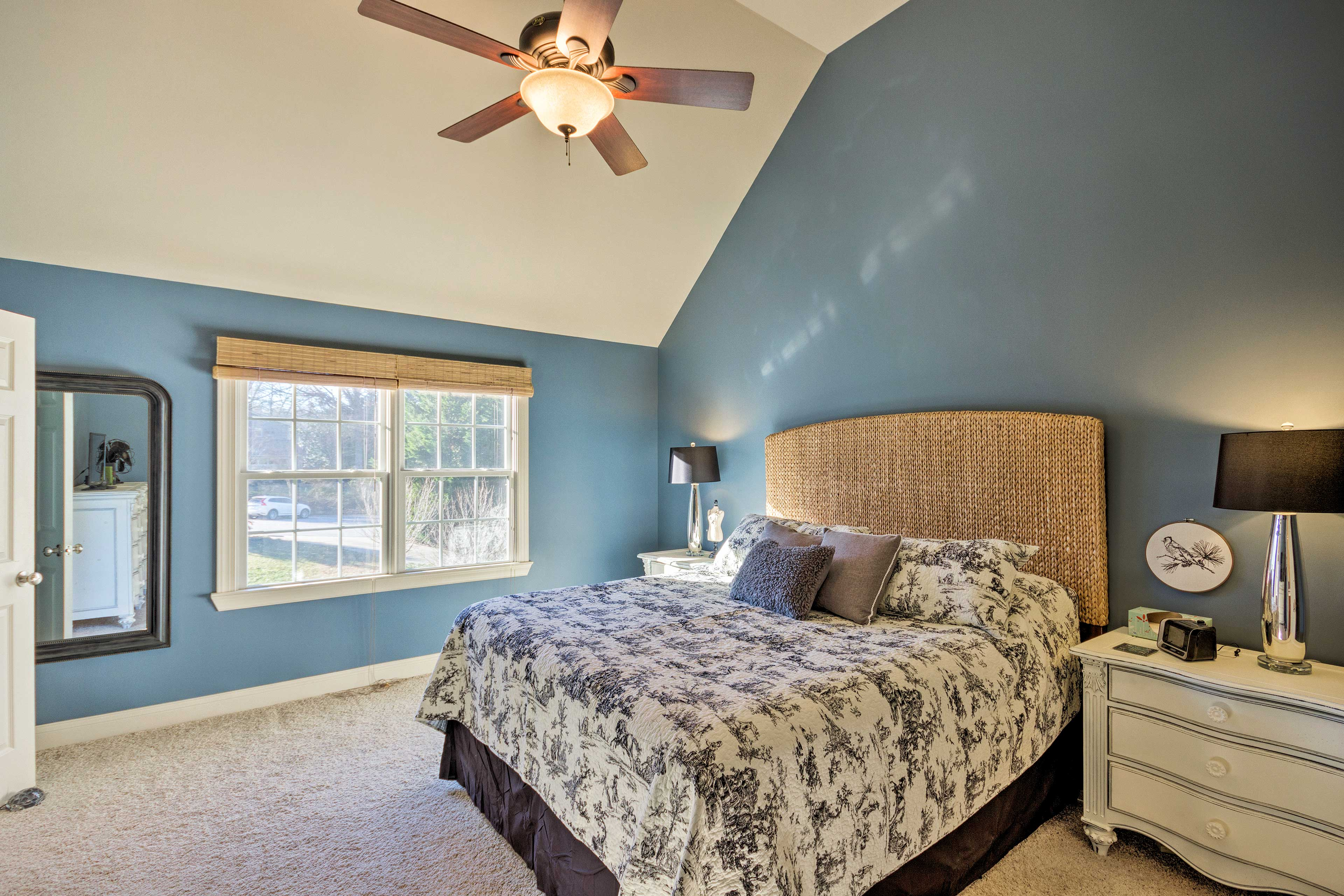 The master bedroom boasts vaulted ceilings.