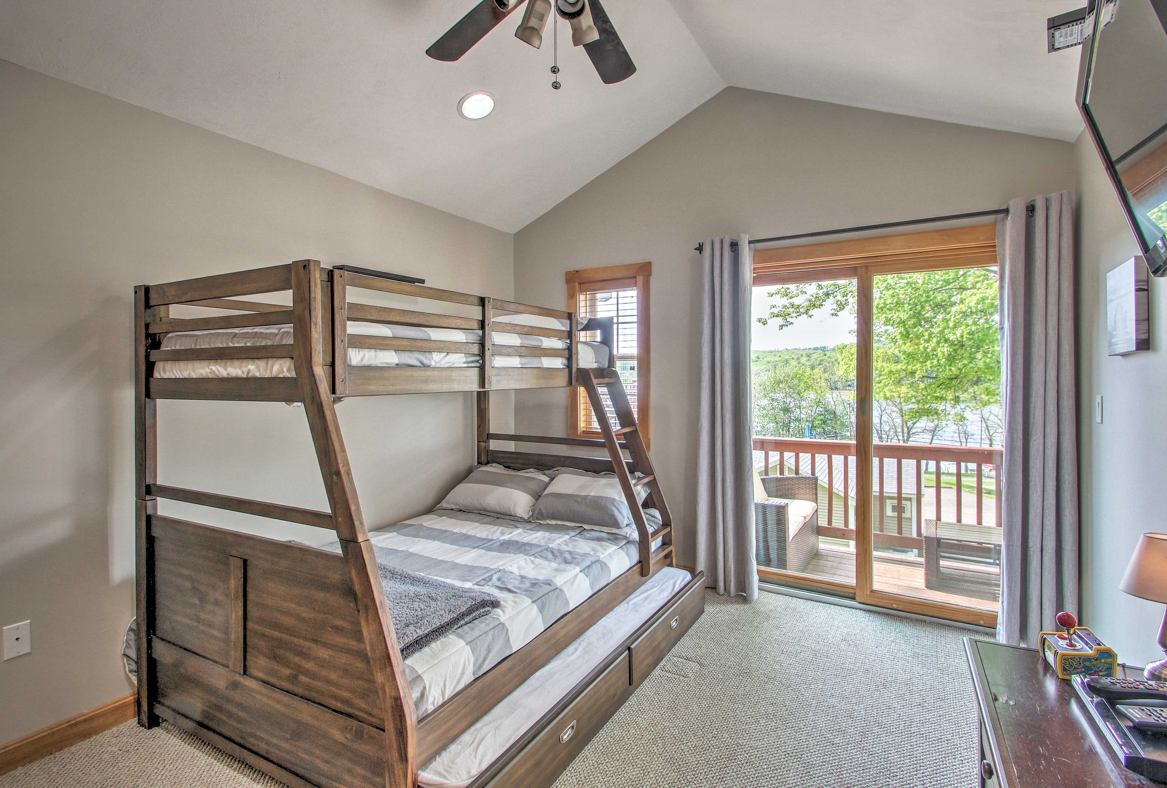 This room has a twin/full bunk bed with a twin trundle bed.