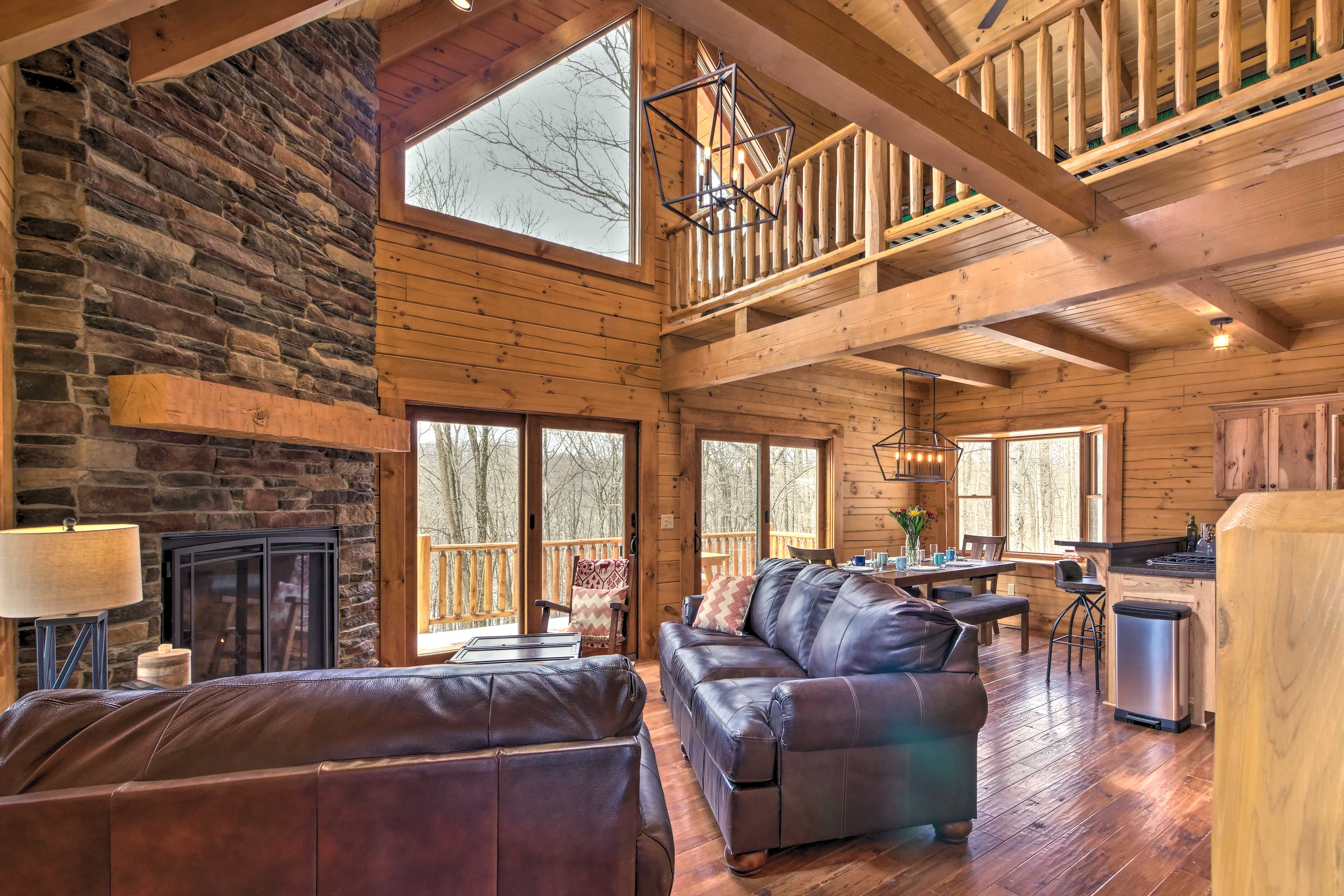 Vaulted ceilings and wood detailing give the space a homey feel.