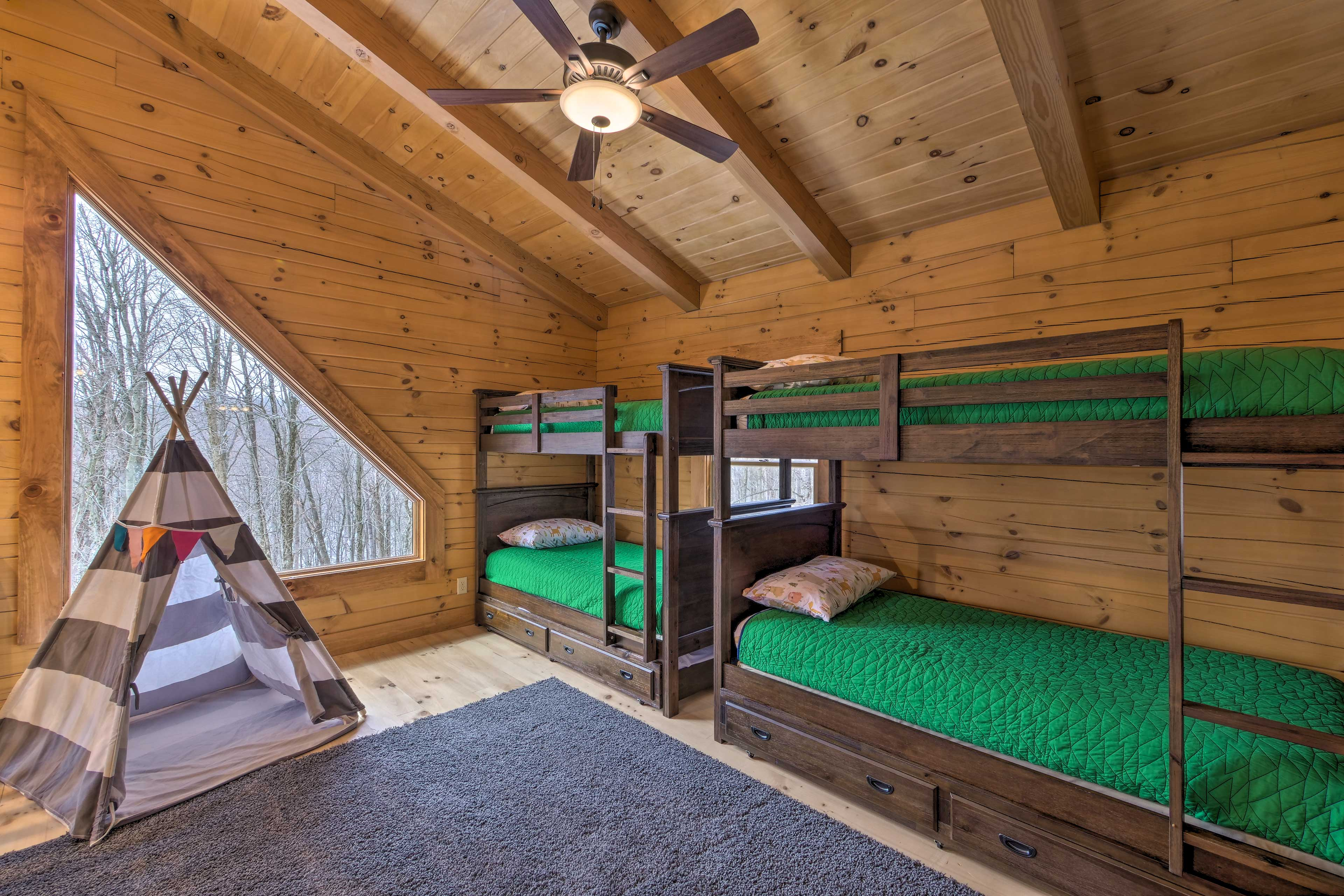 Kids will love sleeping in the 2 twin-over-twin bunk beds.
