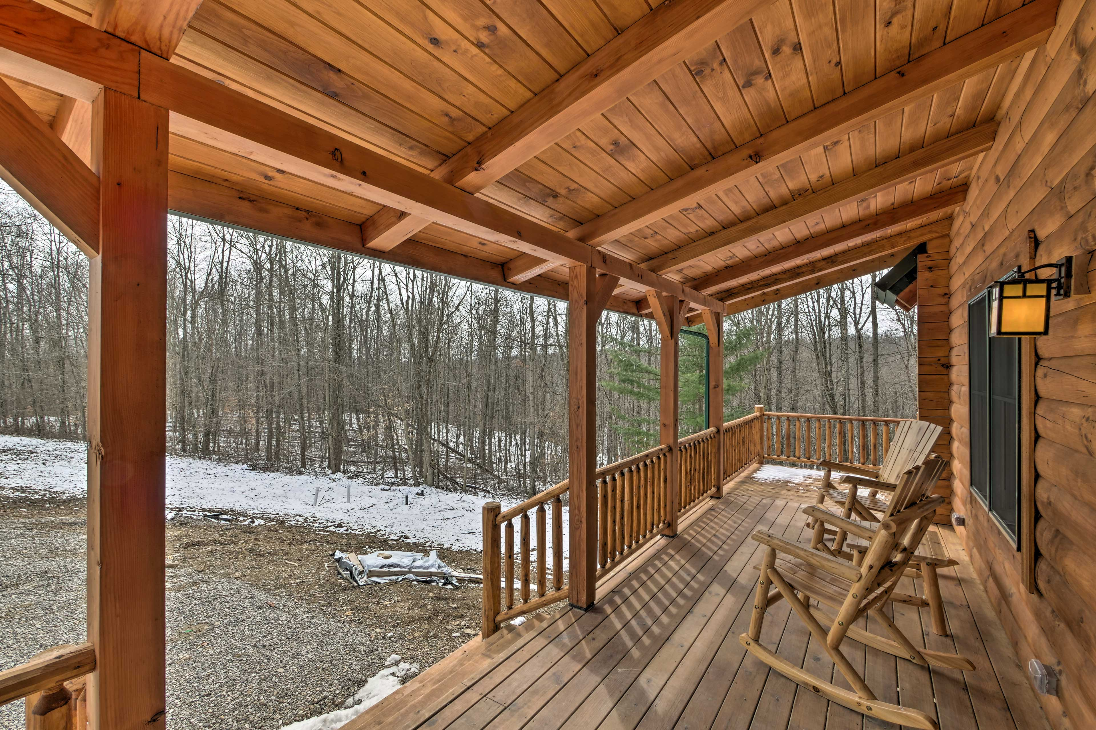 The vacation rental cabin has delightful wooded views.
