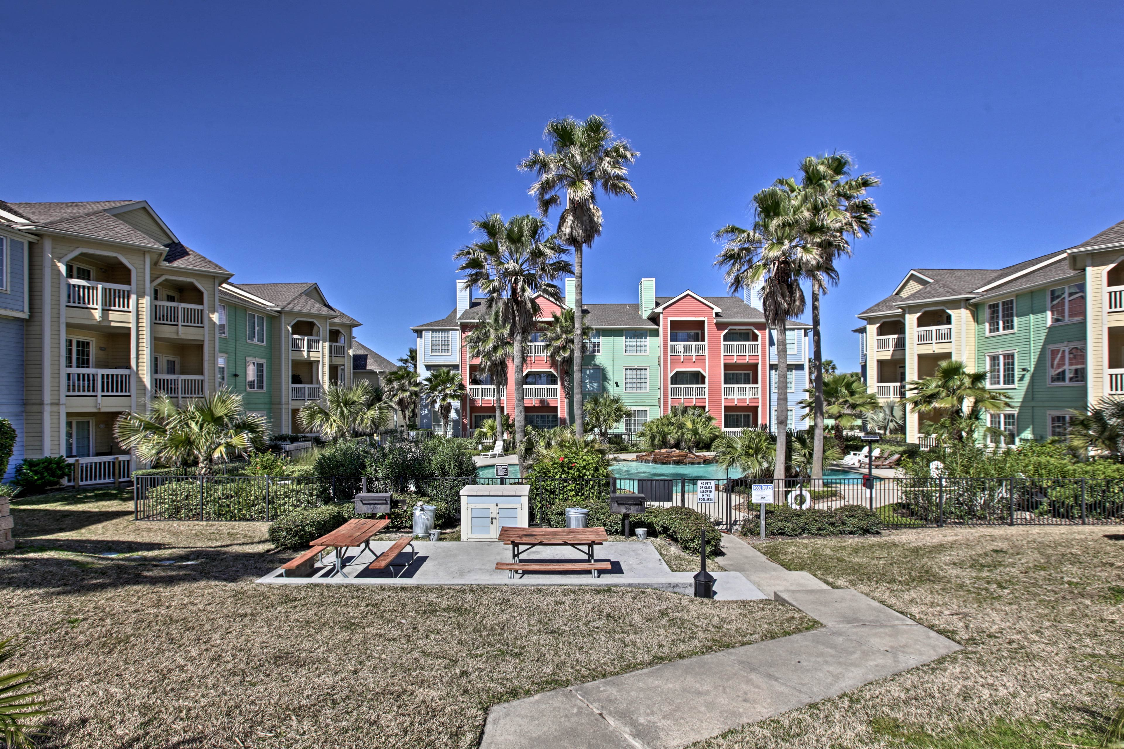 This stunning complex is located just across the street from the beach!