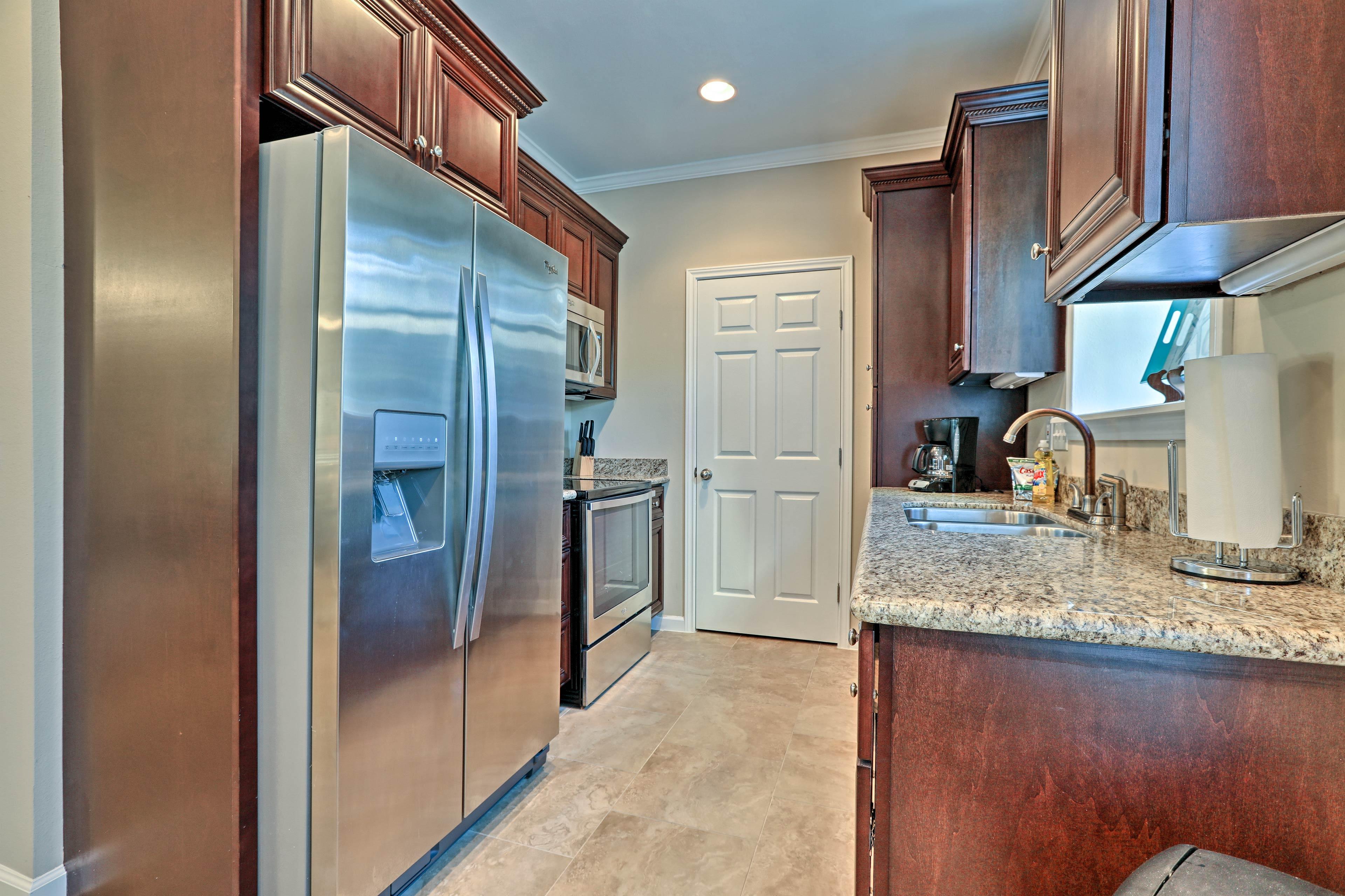 Long granite countertops ensure meal prep is a breeze.