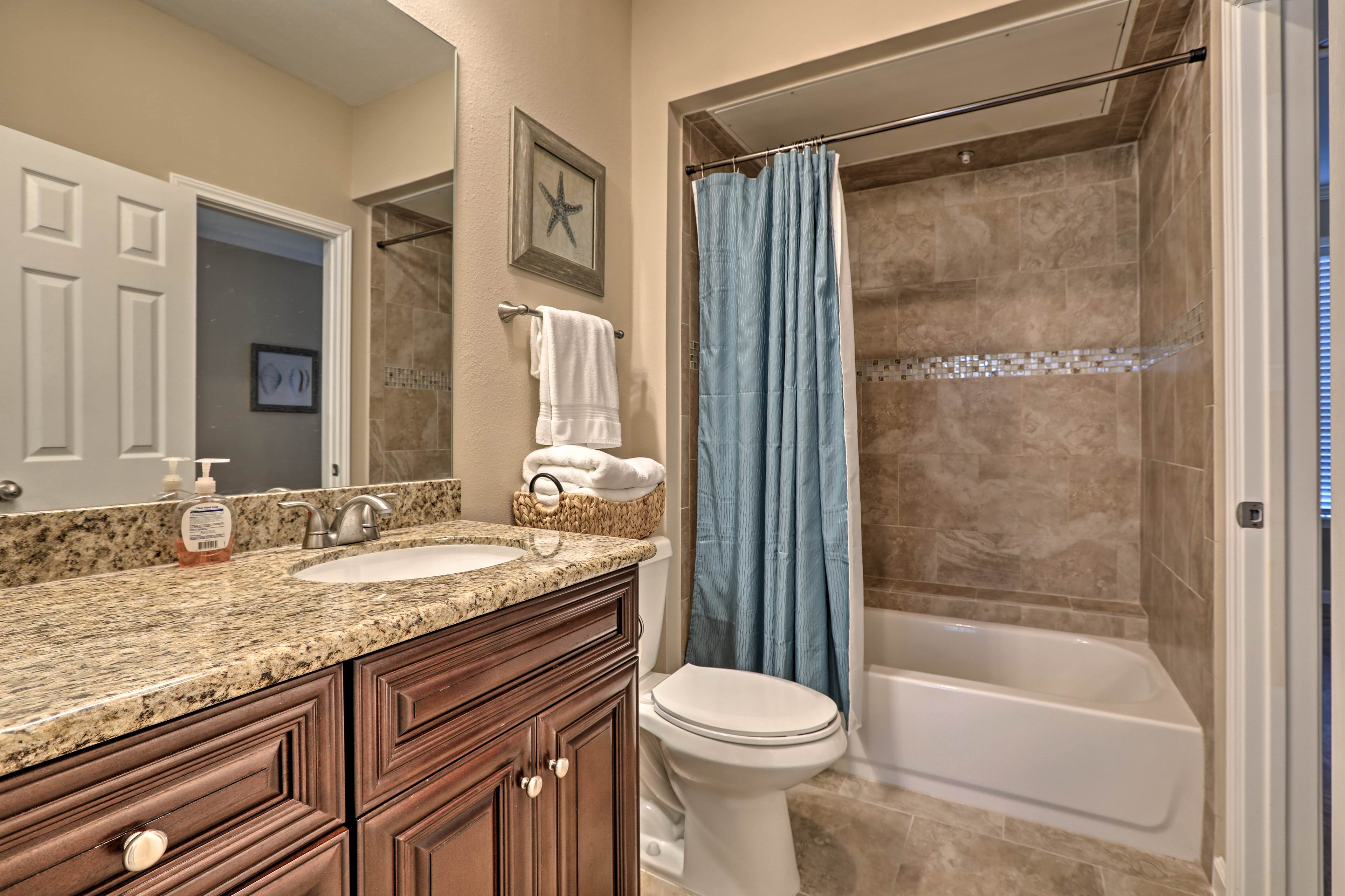 The elegant bathroom is a full with a shower/tub combo.