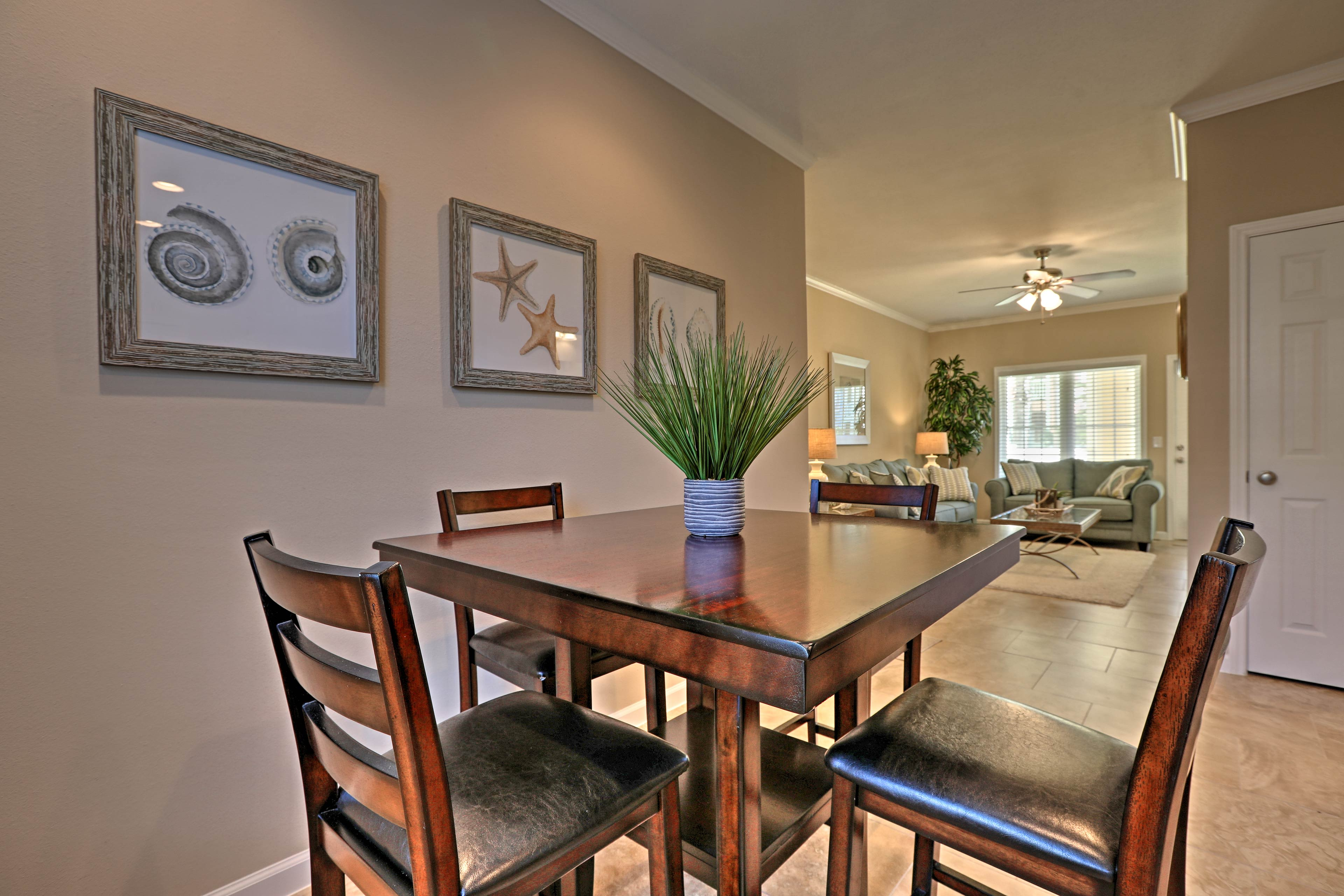 Gather the group for a family dinner at the high-end dining table.