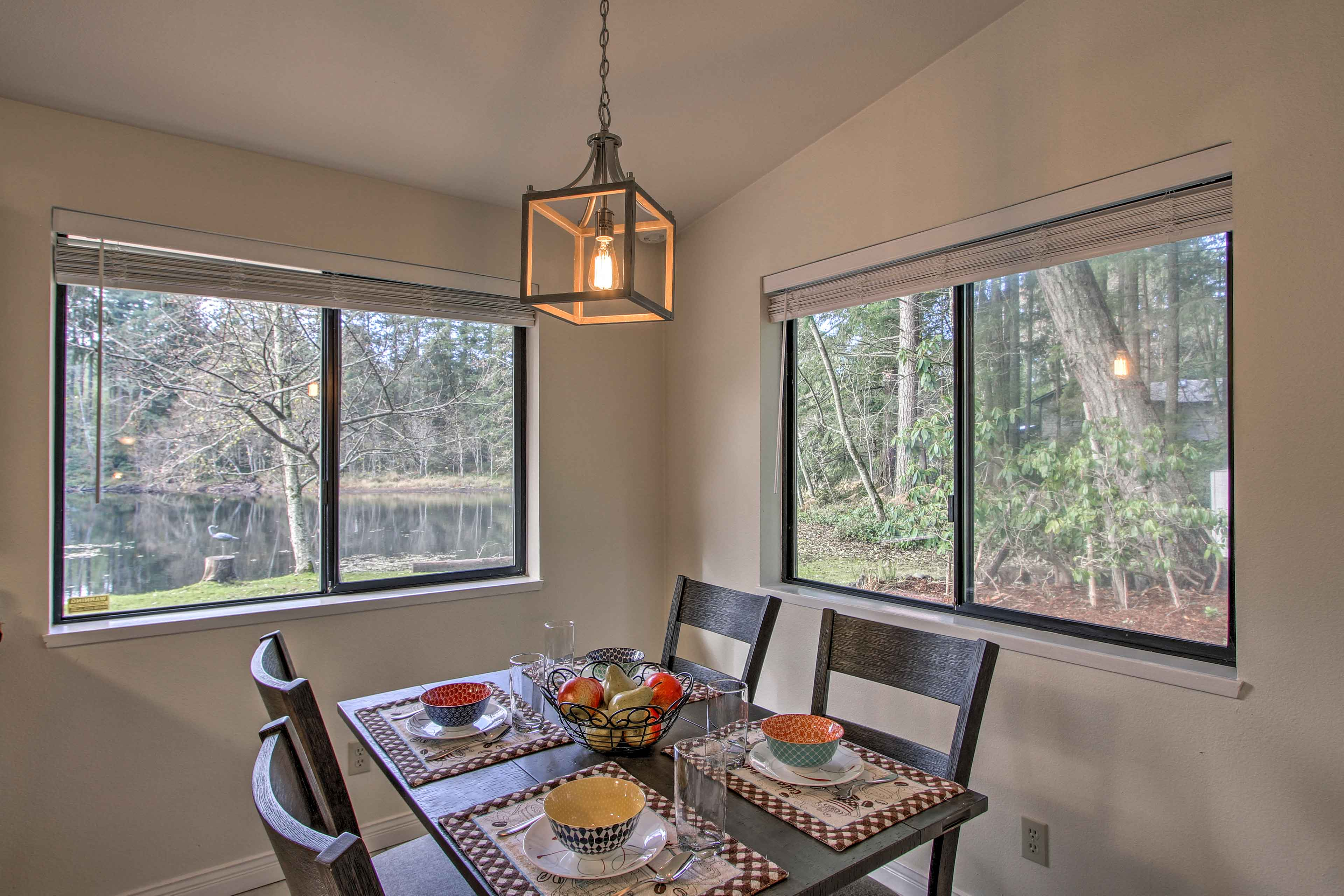 Another dining table with a view of the lake sits off the kitchen.