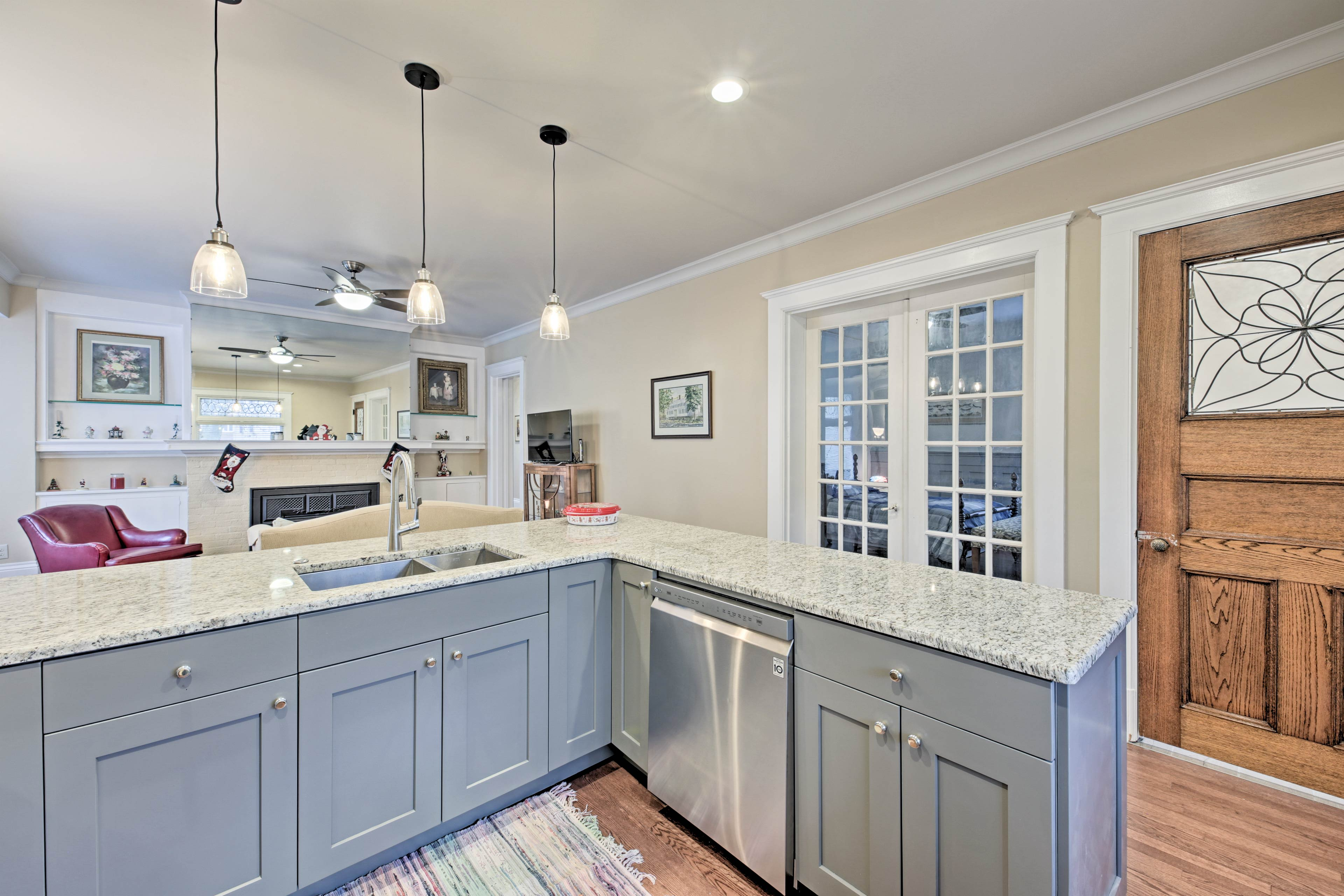 The L-shaped granite counter top provides plenty of space for meal preparation.