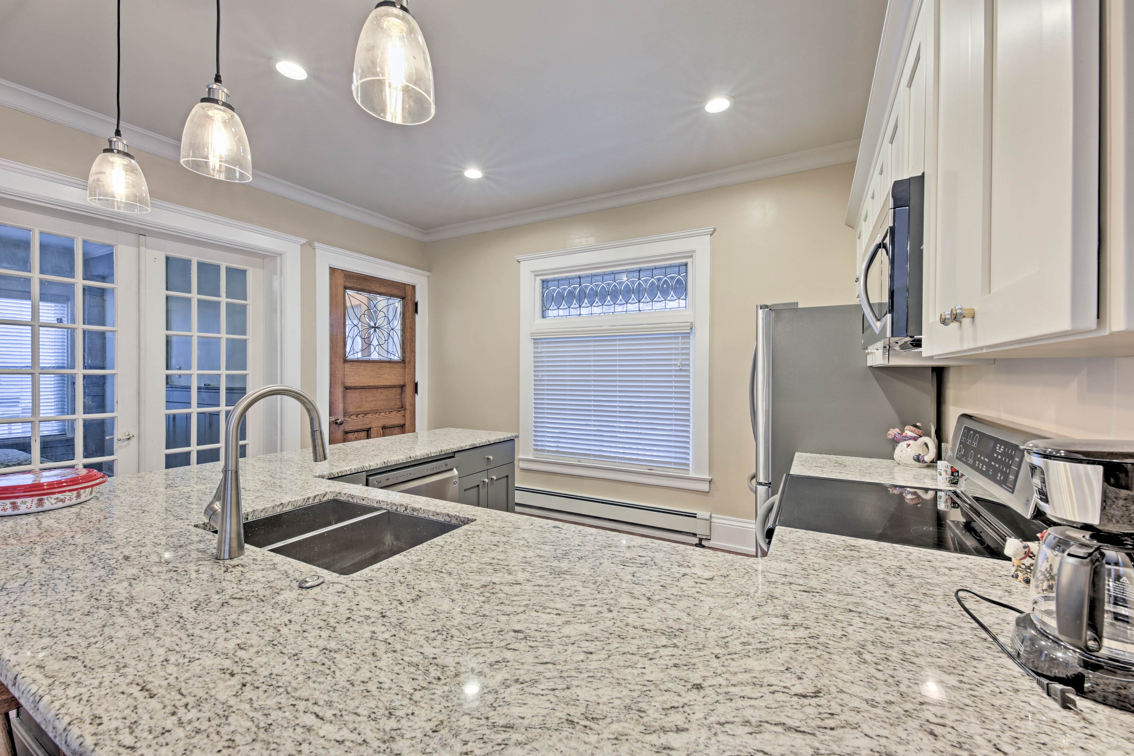 The kitchen is fully equipped with all modern amenities and cookware you'll need