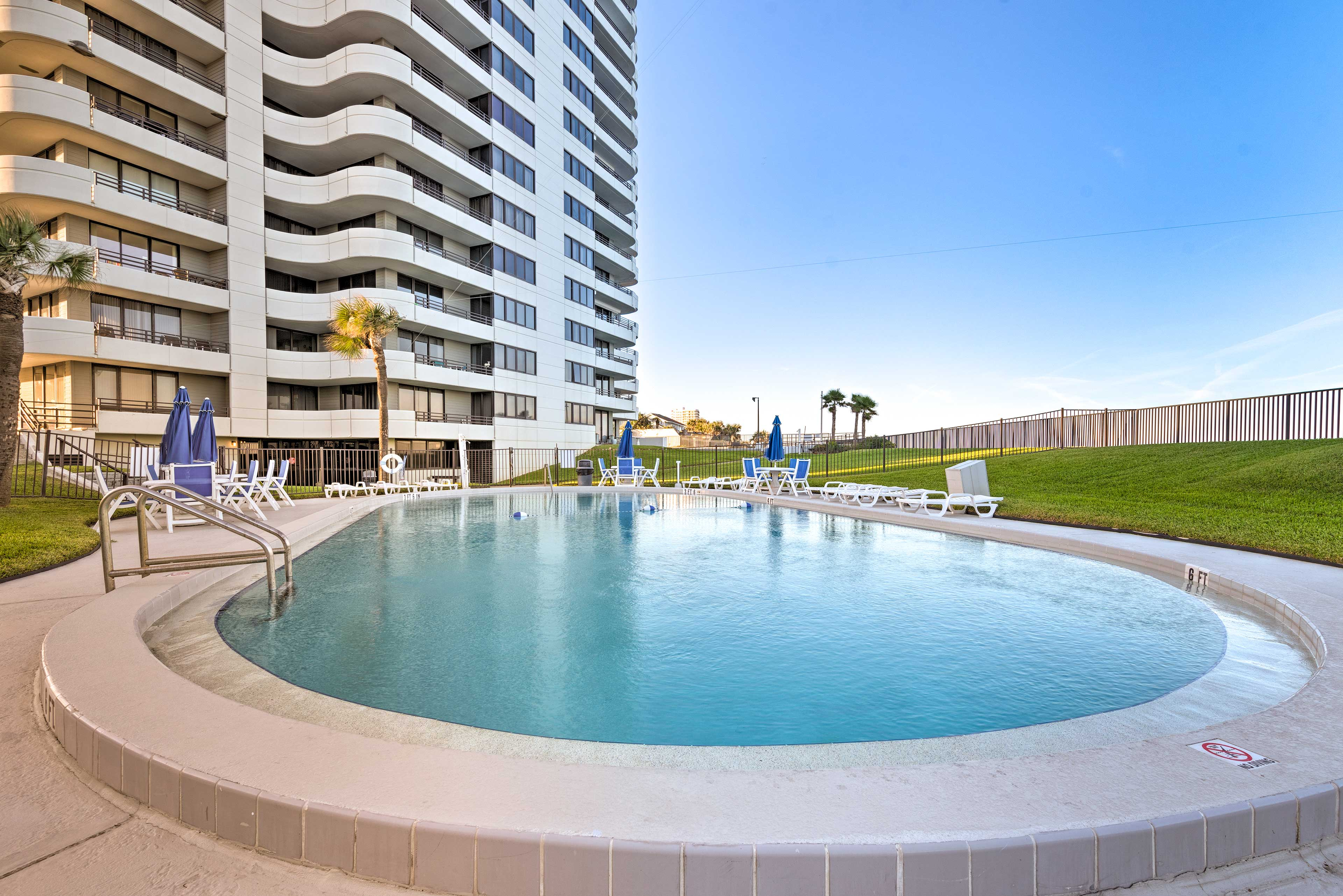 Dive into your next sunny vacation in this Horizons Condos community pool!