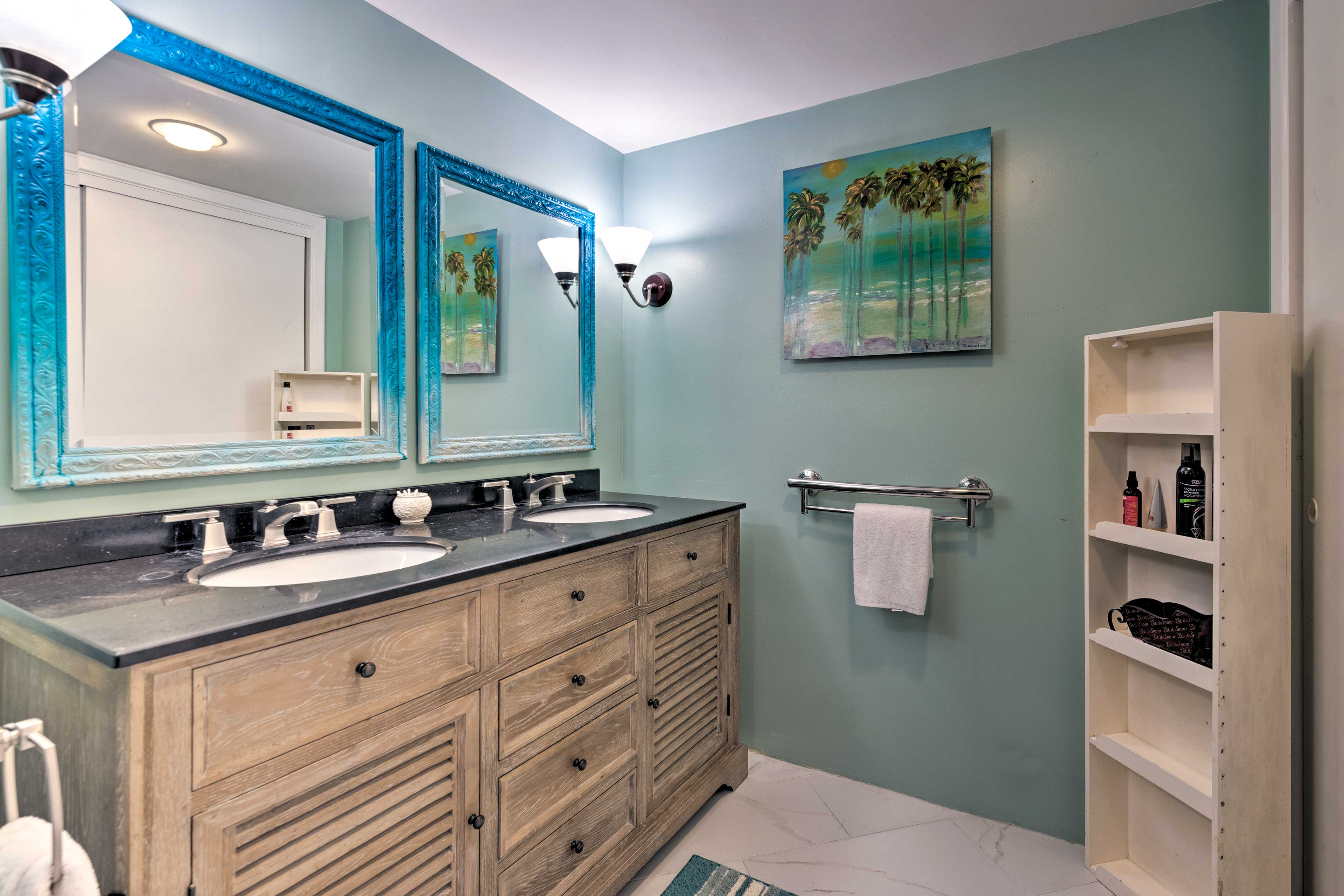 The en-suite bathroom boasts his-and-her sinks.