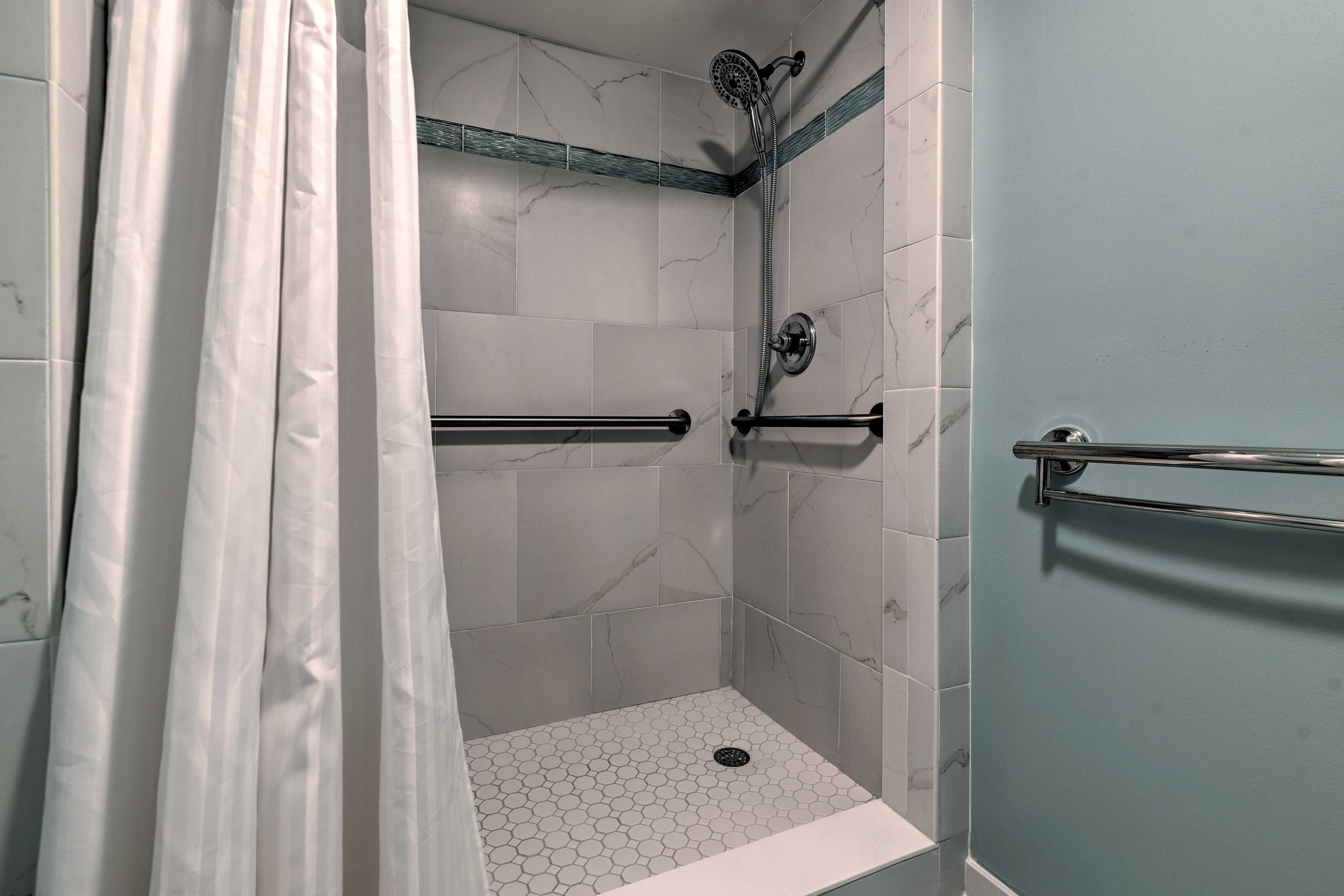 Rinse off in the walk-in shower before crawling under the covers.
