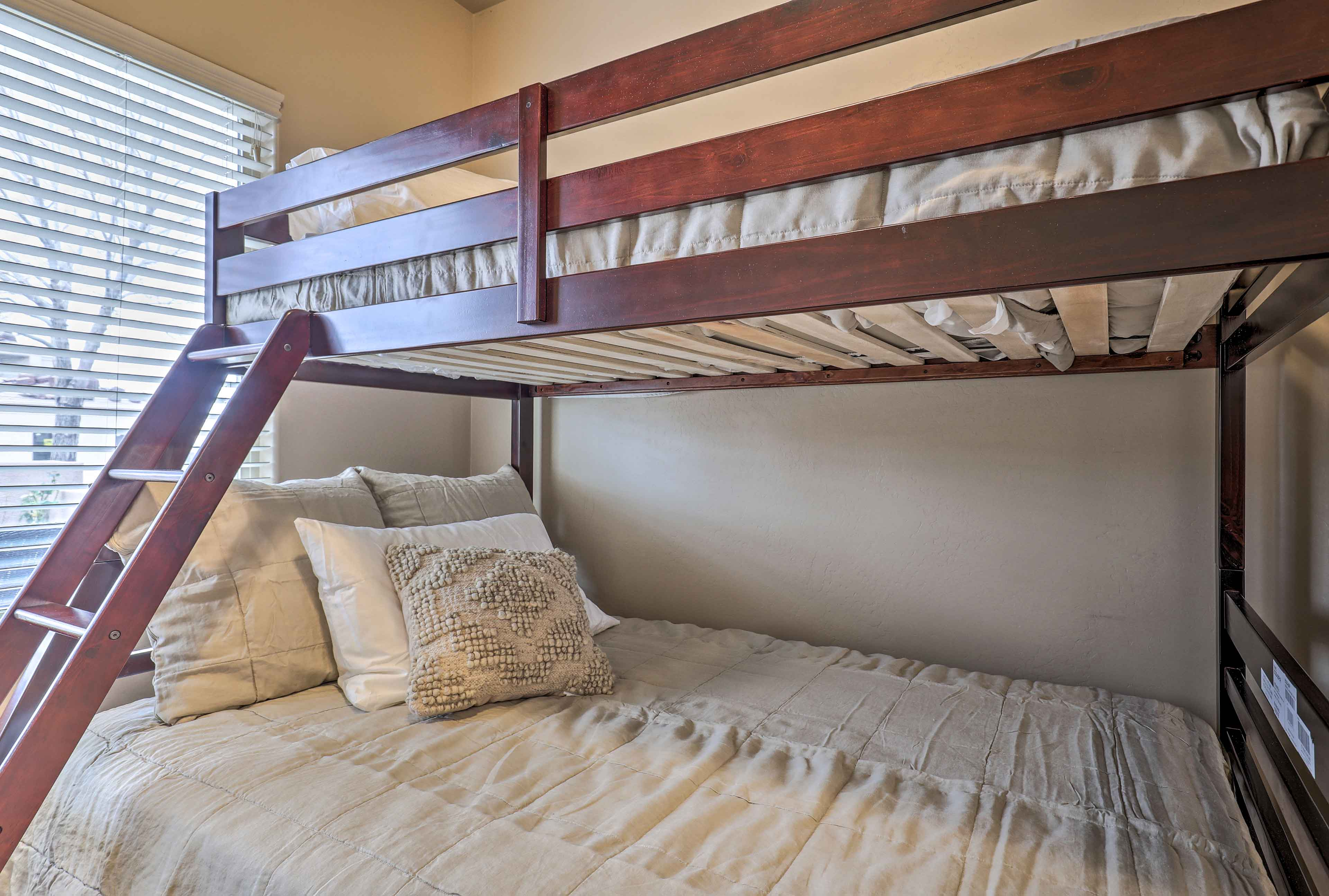 This first guest bedroom includes a twin-over-full bunk bed.