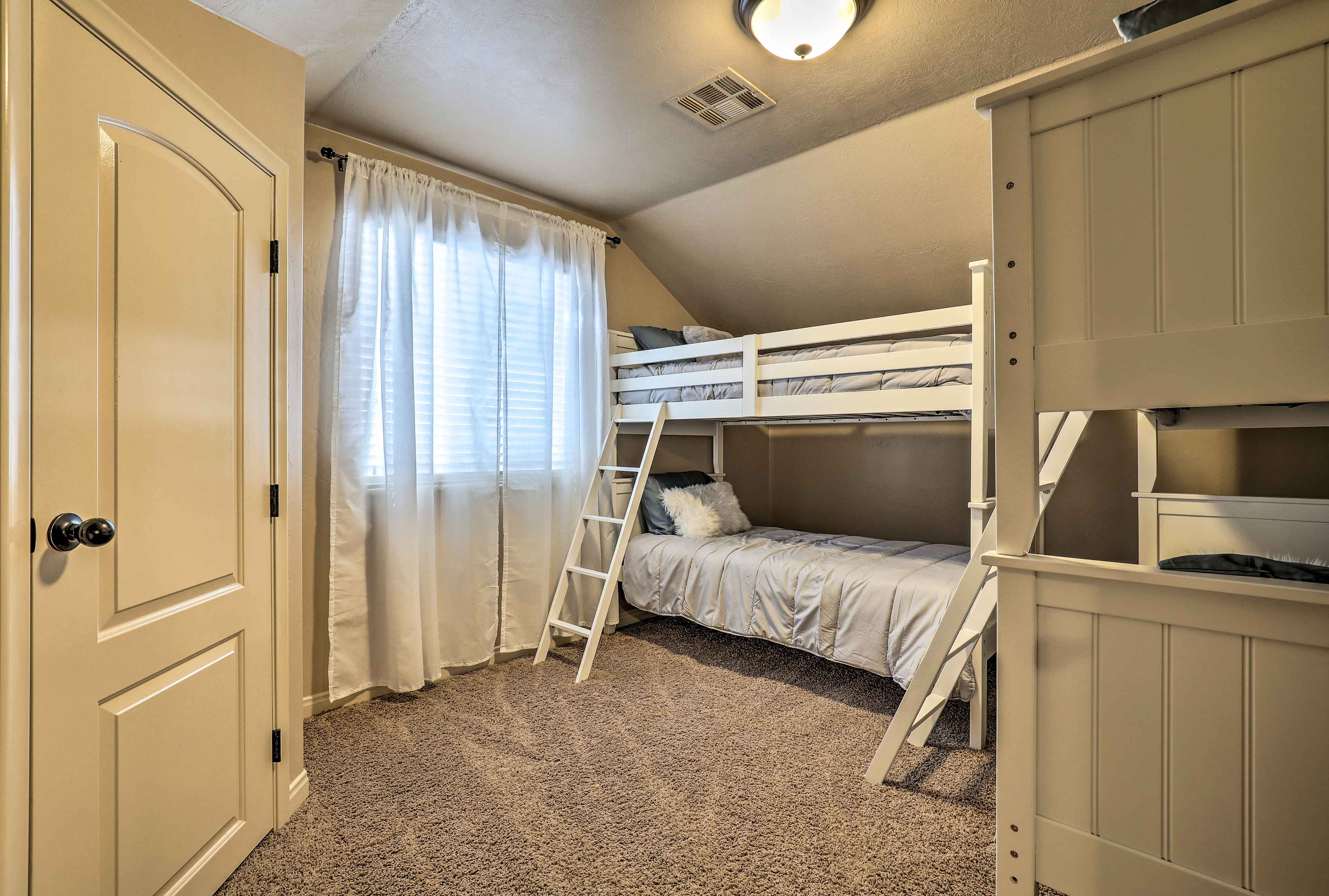 The second bunk room includes 2 twin-over-twin bunk beds.