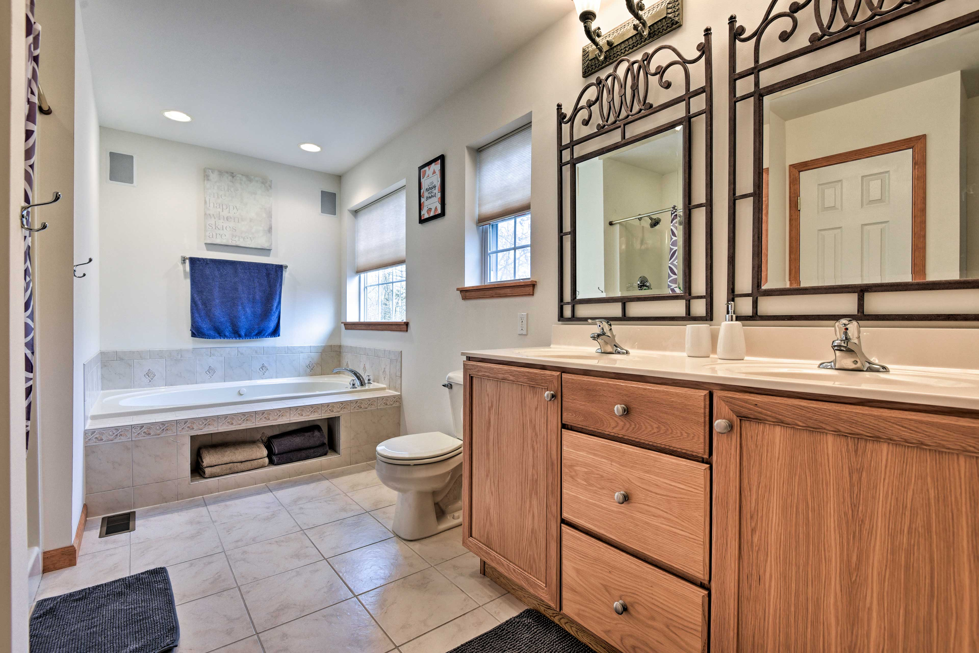 The large en-suite bathroom makes getting ready easy.