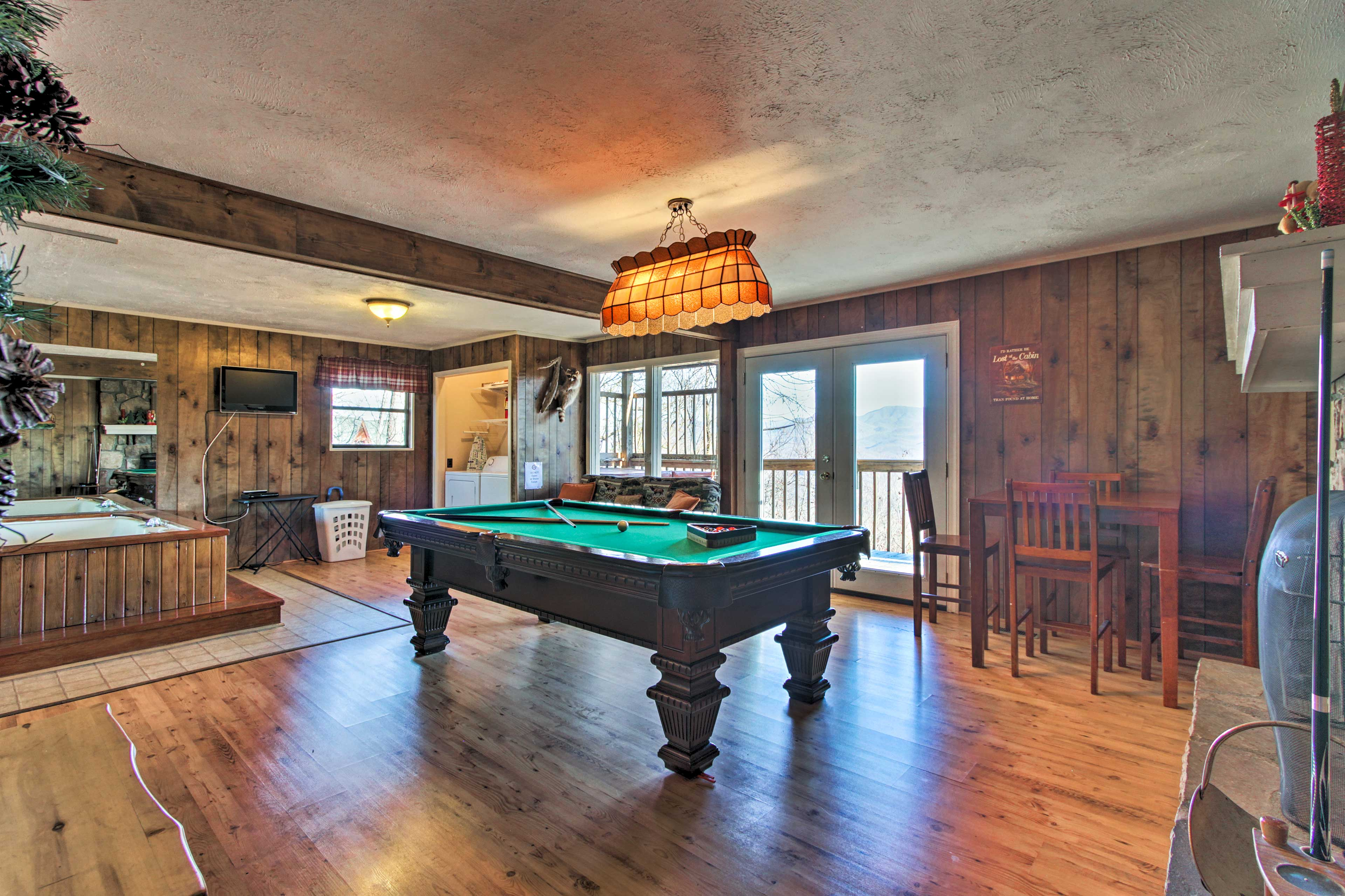 Shoot some pool with loved ones or play cards at the 4-person bar table.