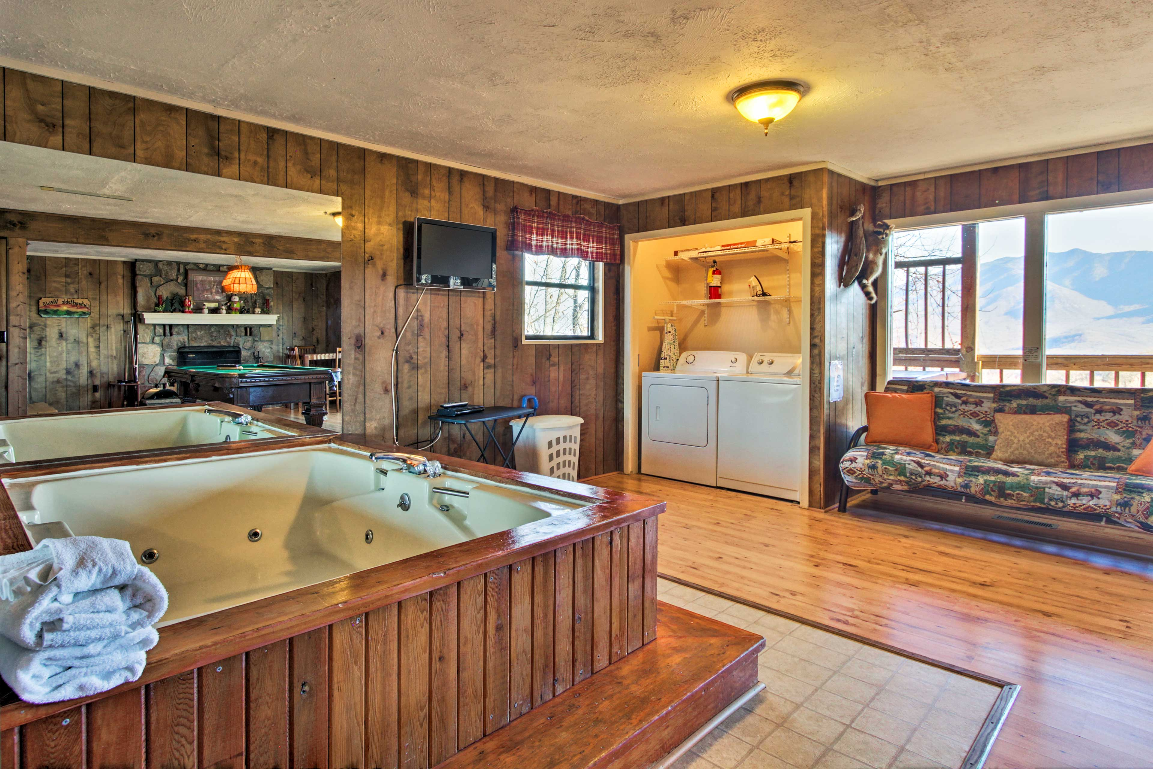 There's a flat-screen cable TV and a large Jacuzzi tub in the room.