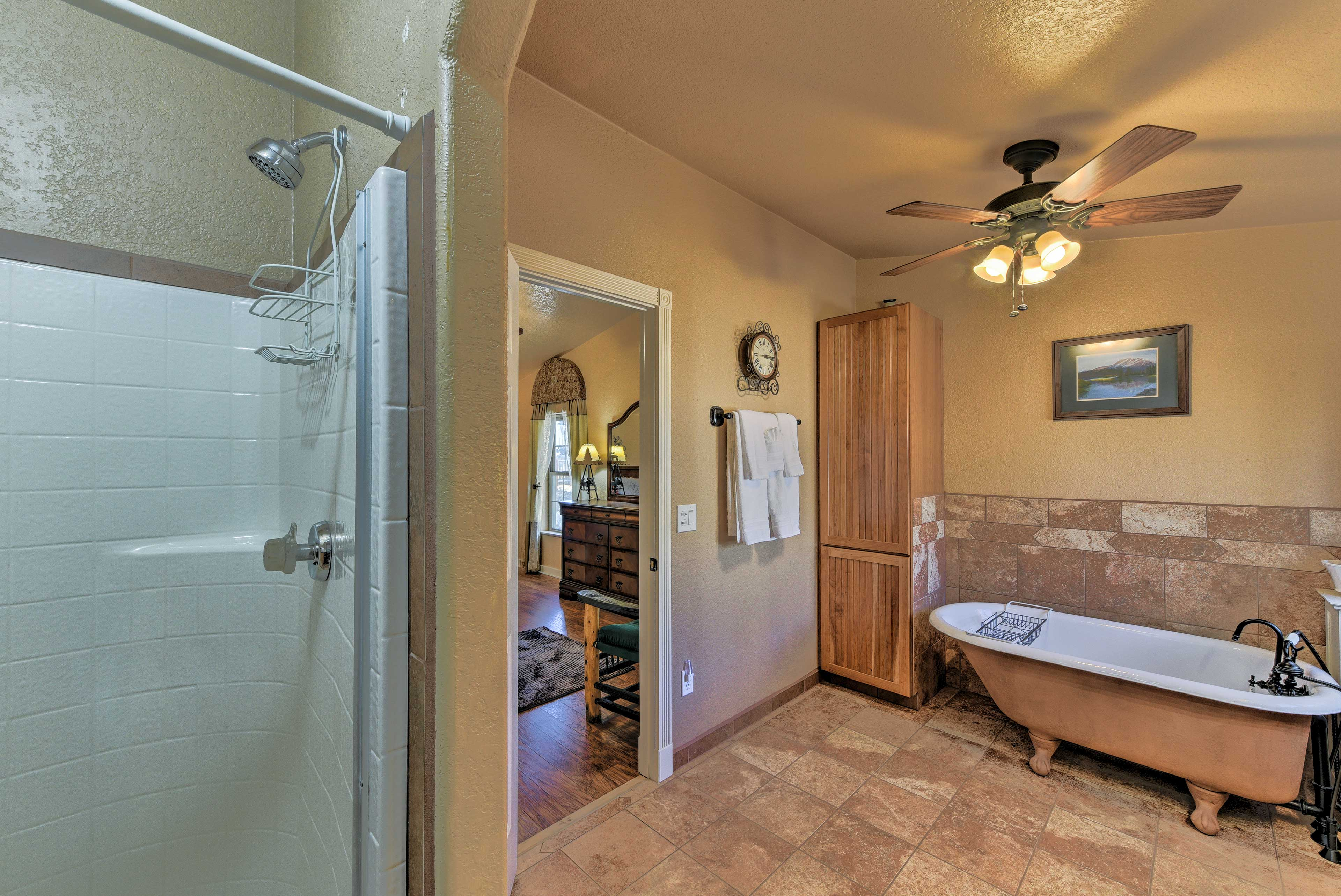 The master bath features a walk-in shower & an antique claw-foot tub.