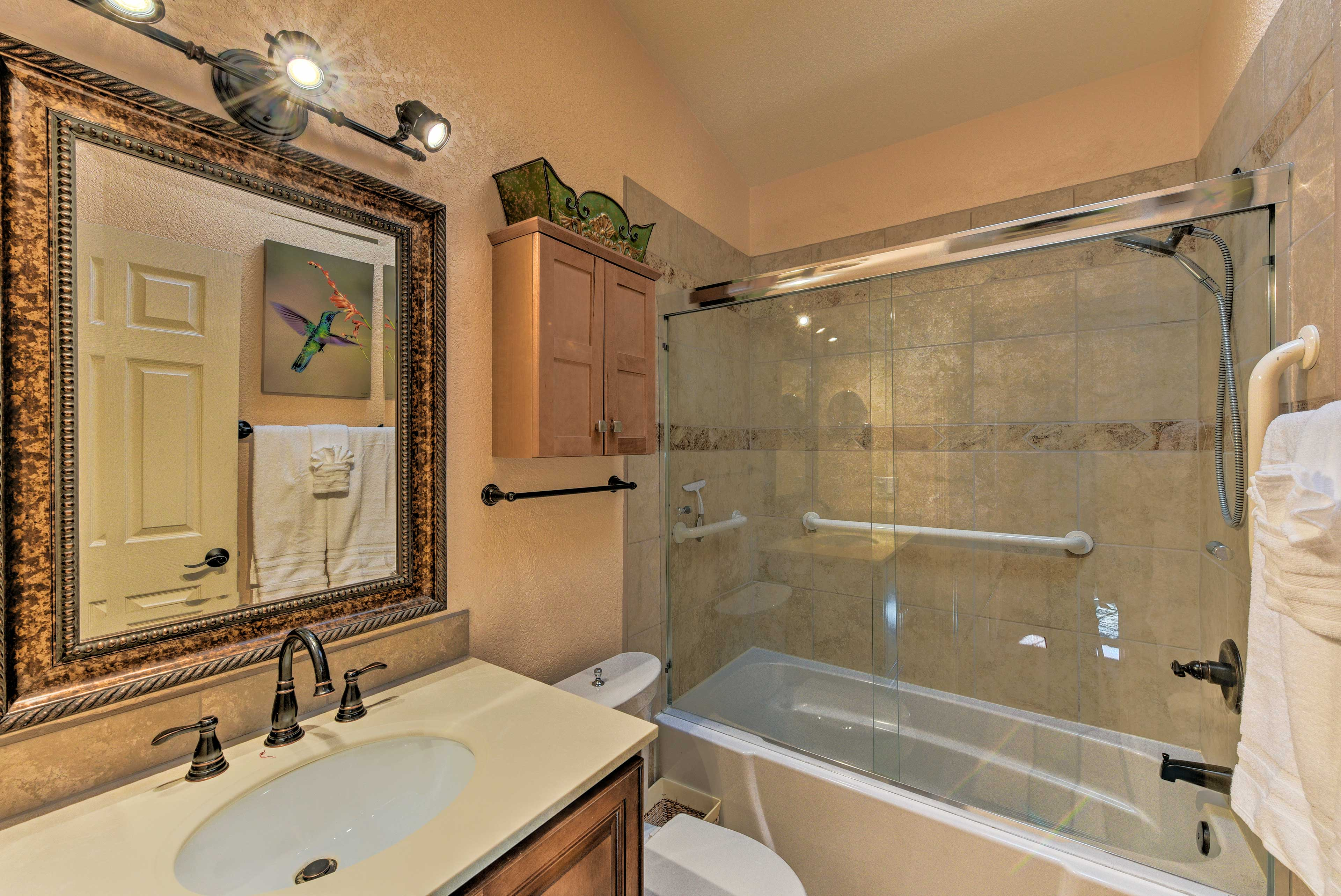 Rinse off in this lavish shower/tub combo!