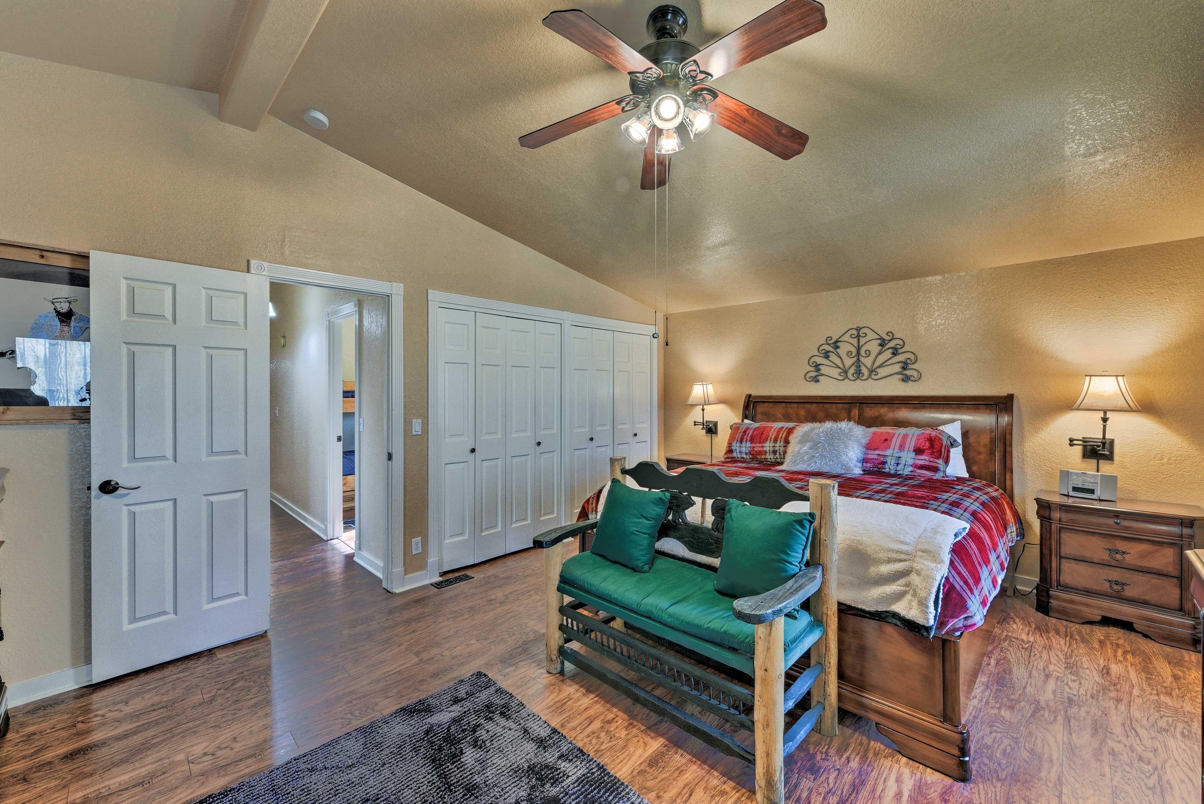 The master bedroom boasts hardwood floors & ample closet space.