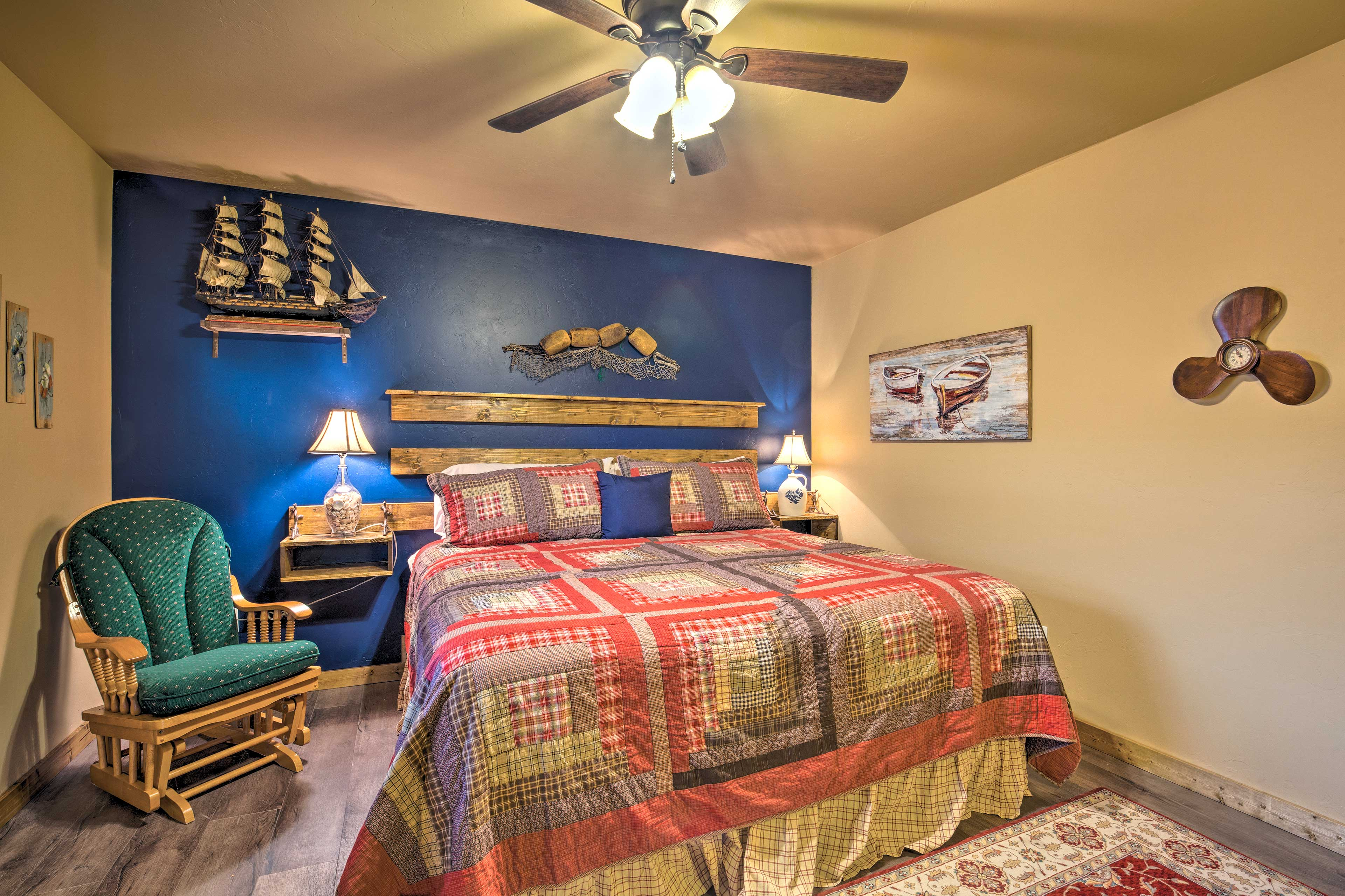 The master bedroom boasts a nautical theme and king-sized bed.